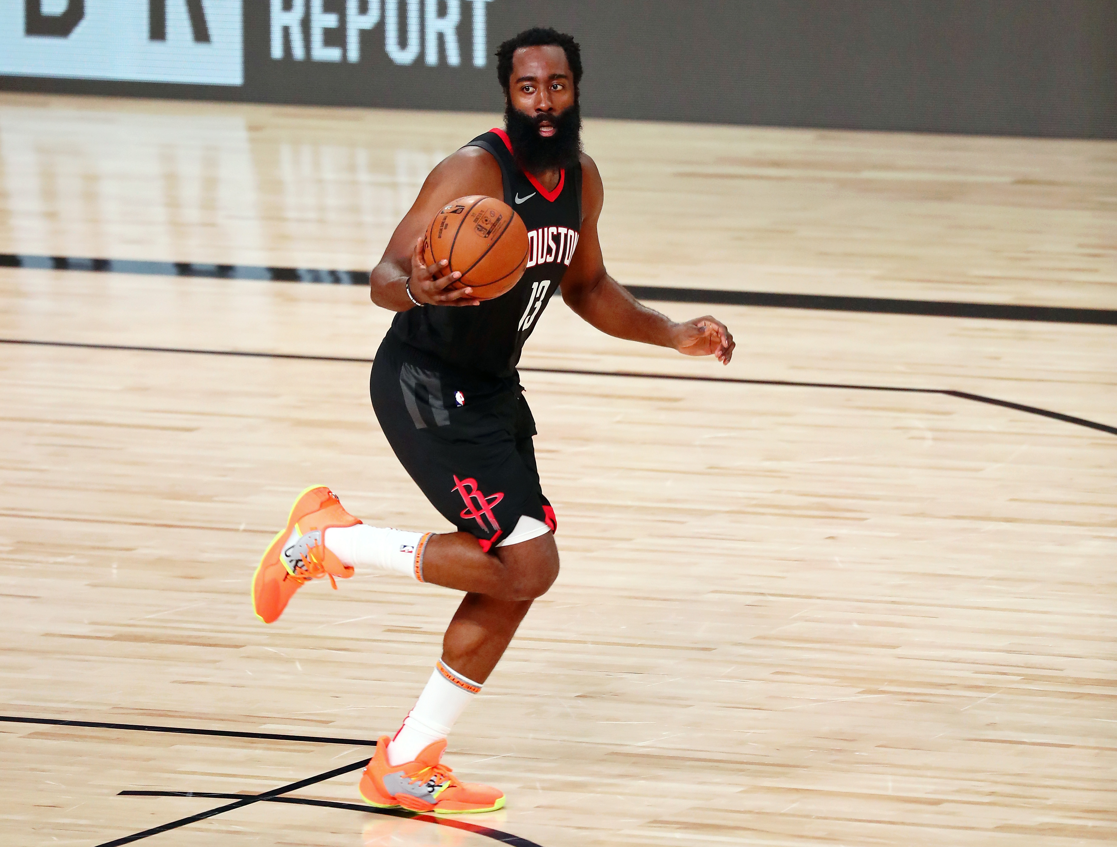 James Harden of the Houston Rockets brings the ball up court against the Los Angeles Lakers in the second half at The Arena at ESPN Wide World Of Sports Complex on August 6, 2020 in Lake Buena Vista, Florida.