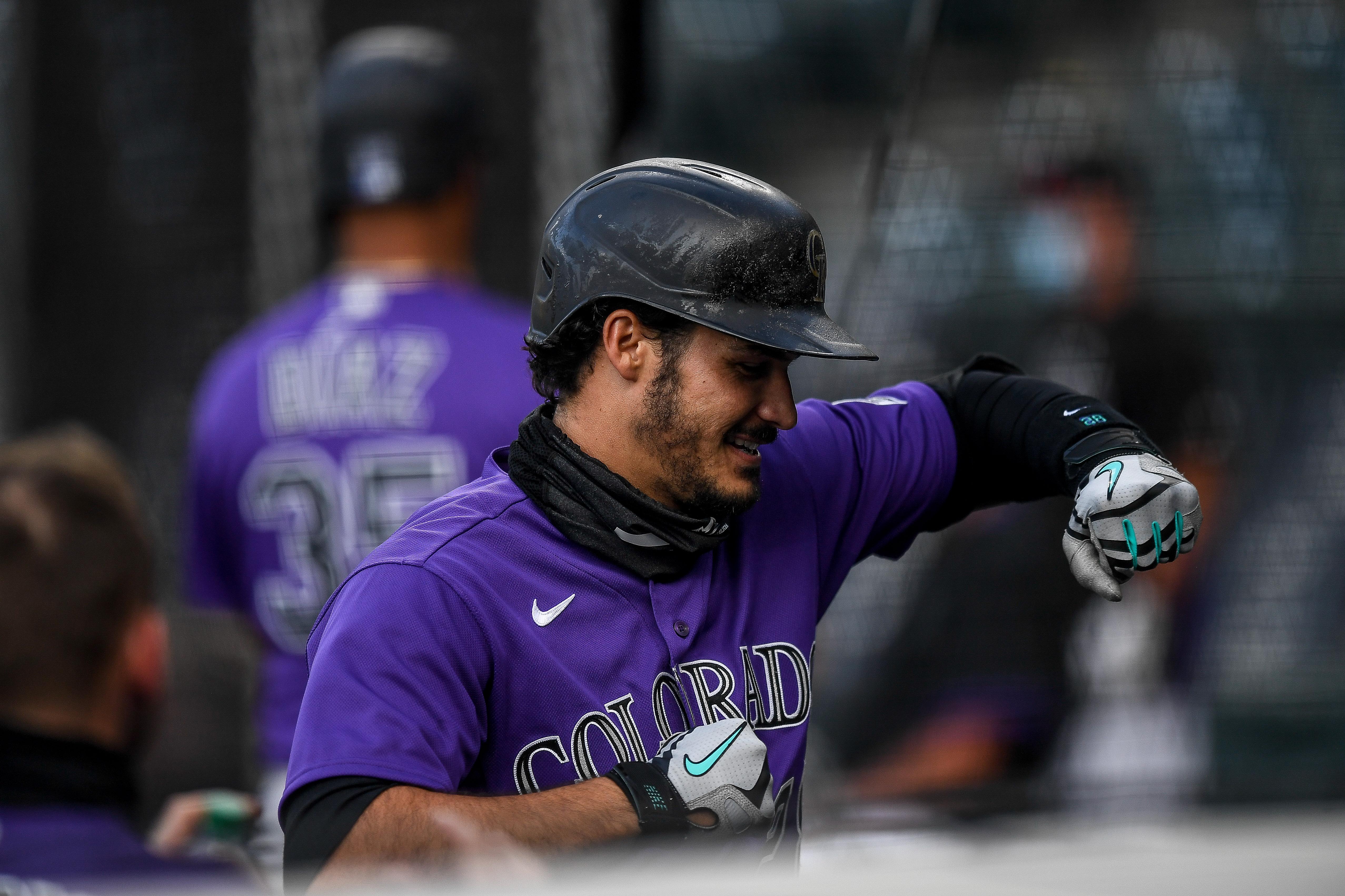 Nolan Arenado celebrates with a virtual elbow bump.