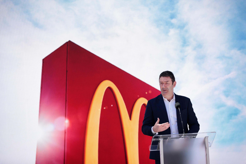 McDonald's Steve Easterbrook standing at a podium.