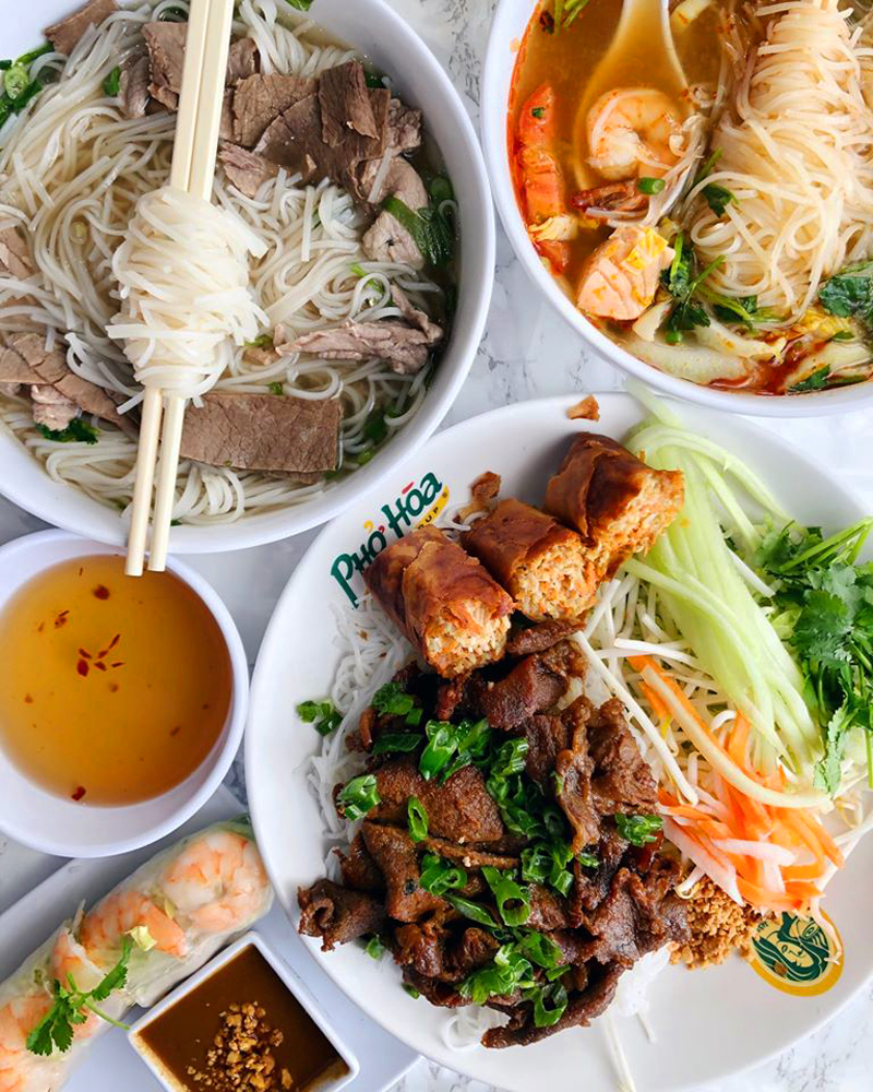 Bowls of pho noodle soup and grilled pork and fried rolls, on the menu at Pho Hoa and Jazen Tea in Henderson.