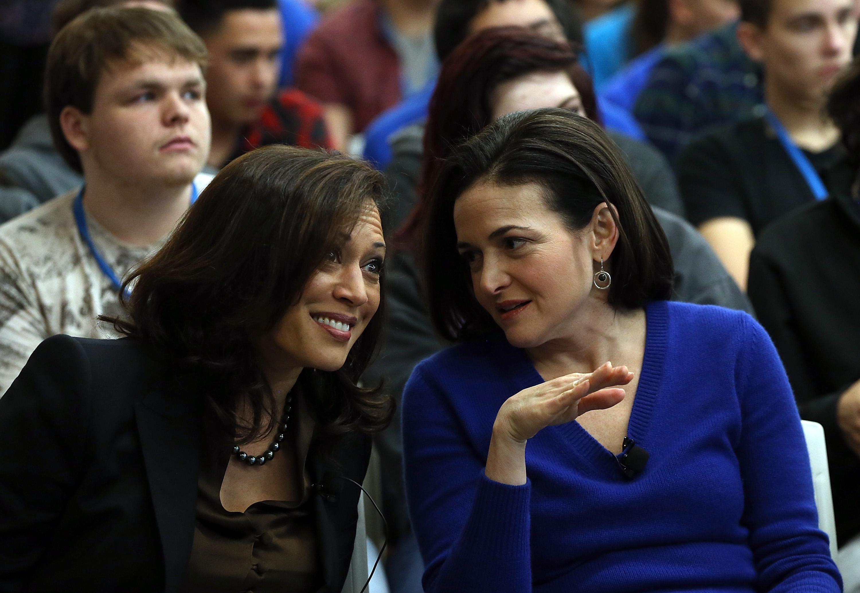 Sen. Kamala Harris (left) smiles as she speaks with Facebook COO Sheryl Sandberg.