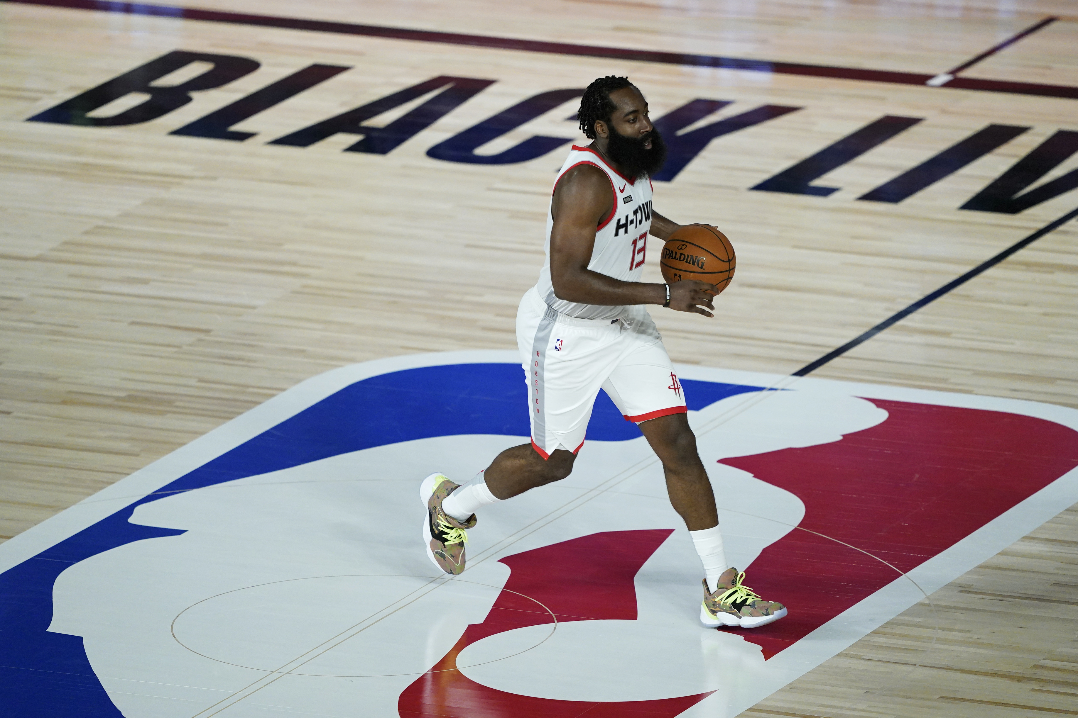 James Harden of the Houston Rockets dribbles down the court against the Sacramento Kings during the first half at HP Field House at ESPN Wide World Of Sports Complex on August 9, 2020 in Lake Buena Vista, Florida.