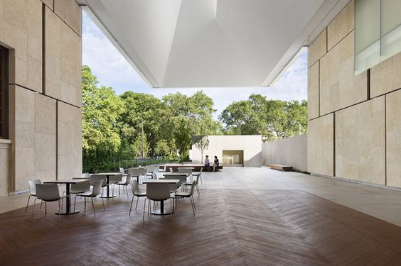 tables set up outside in building courtyard