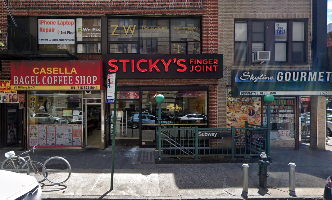 """The exterior of a restaurant with """"Sticky's"""" in red block lettering"""