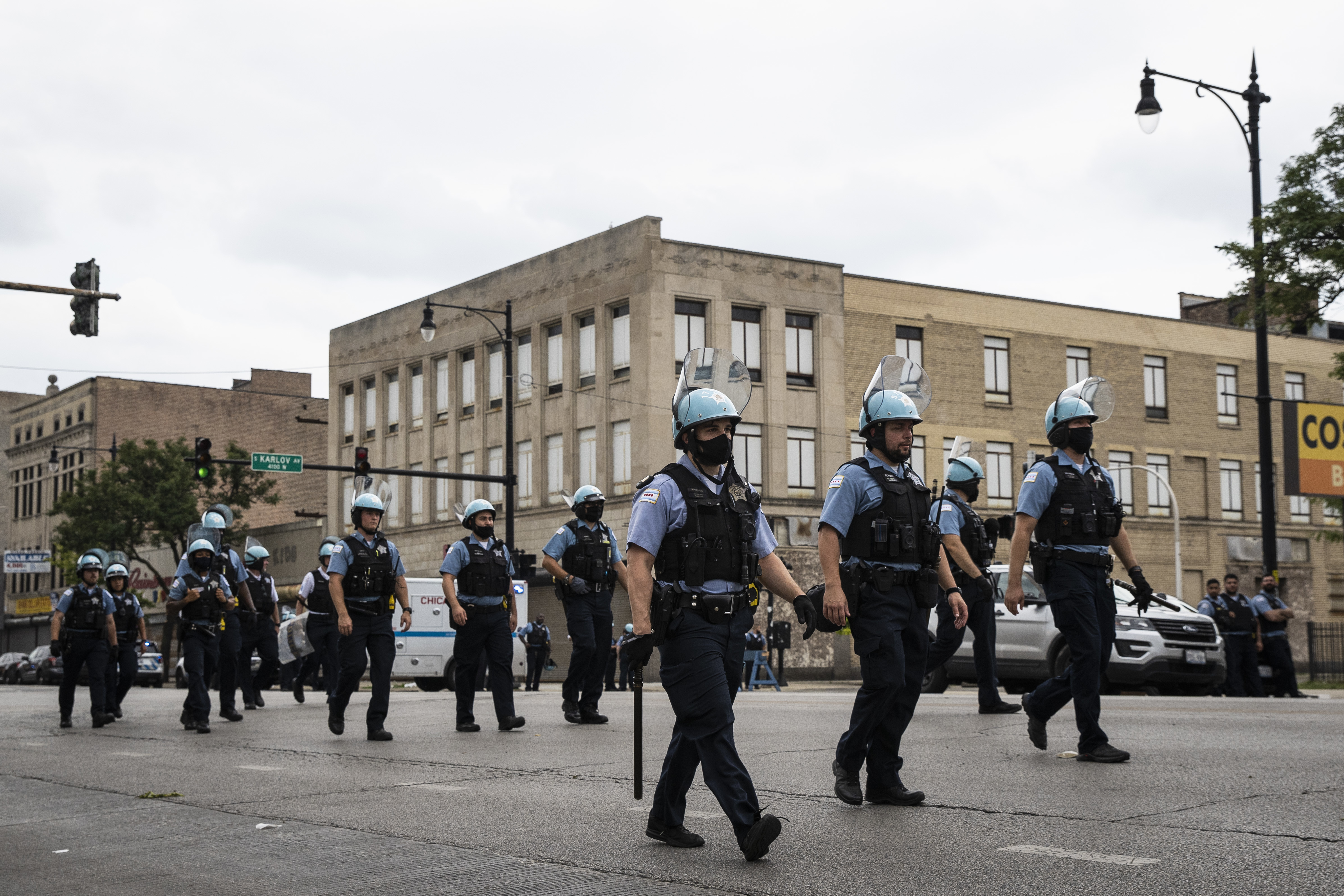 Chicago police officers respond to reports of looting and rioting near West Madison Street and South Karlov Avenue on the West Side, Monday afternoon, Aug. 10, 2020.