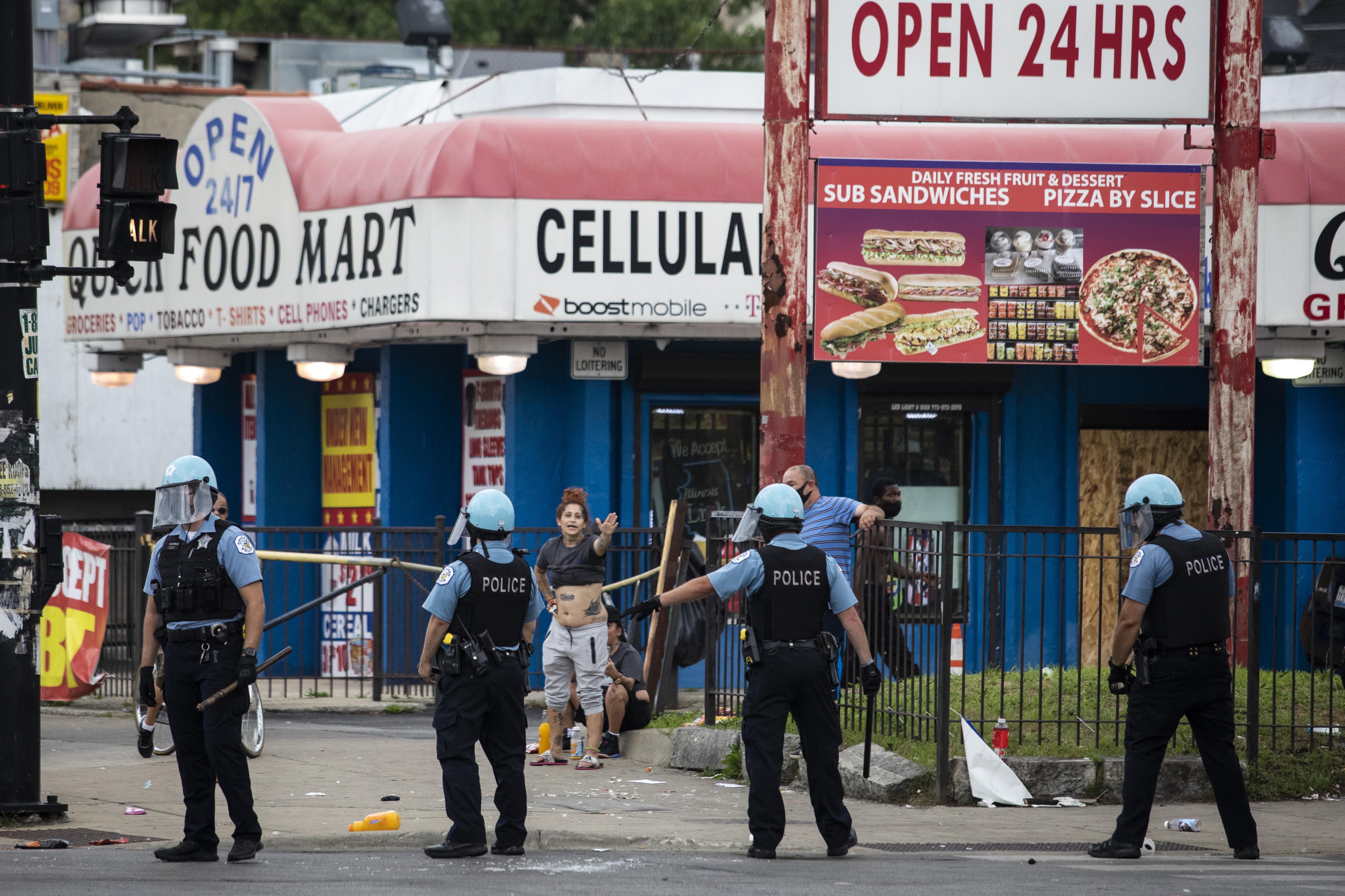 Chicago police officers respond to looting and rioting near West Madison Street and South Keeler Avenue on the West Side, Monday afternoon, Aug. 10, 2020.