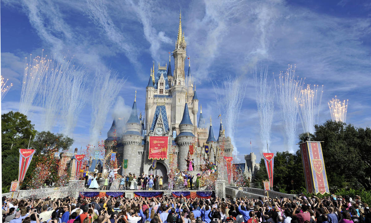 This image released by Disney shows fireworks punctuating the sky at the grand opening celebration at the Cinderella Castle for the New Fantasyland attraction at the Walt Disney World Resort's Magic Kingdom theme park in Lake Buena Vista, Fla., Thursday,
