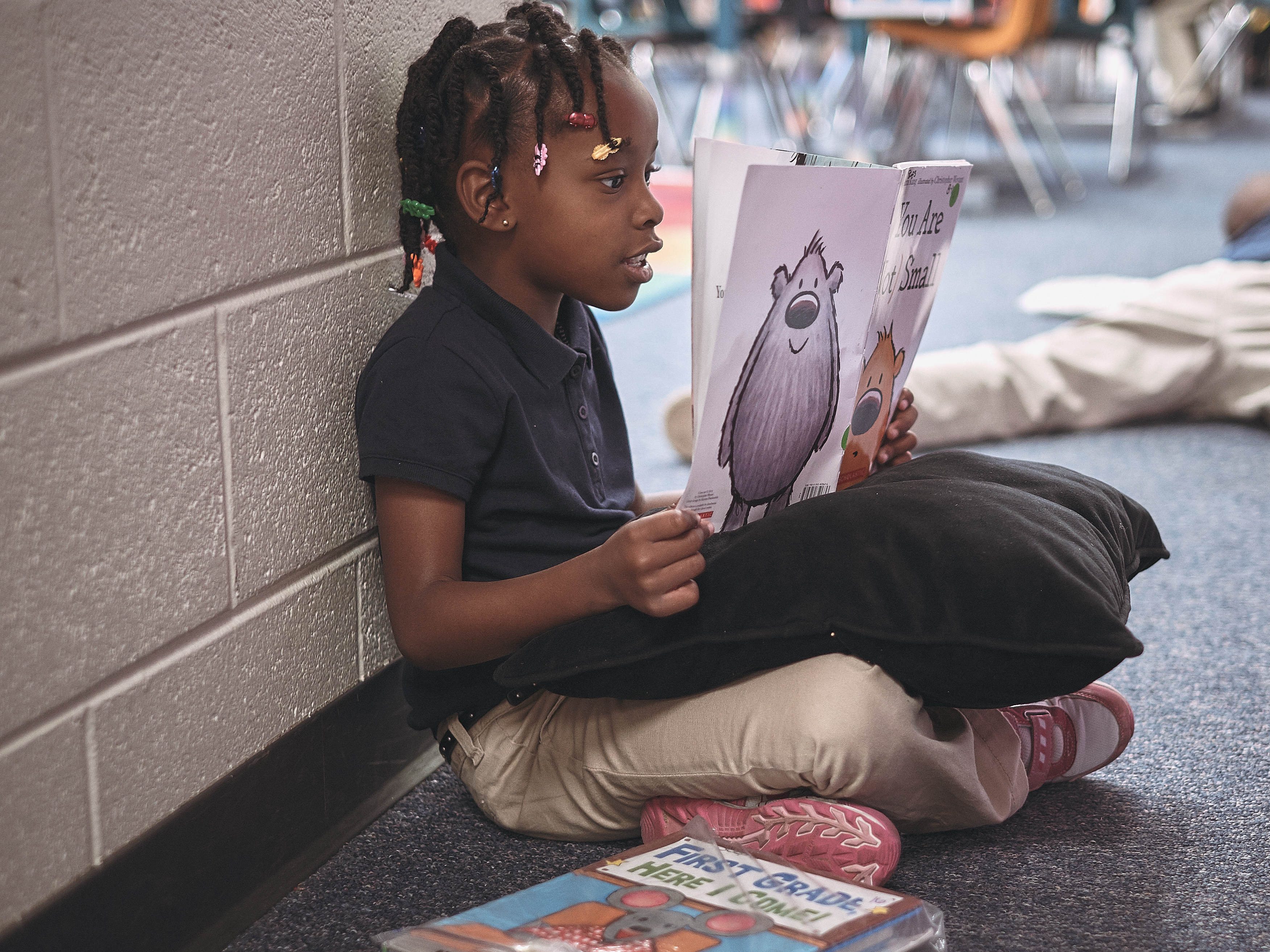 A McGlone first grader practices her reading.
