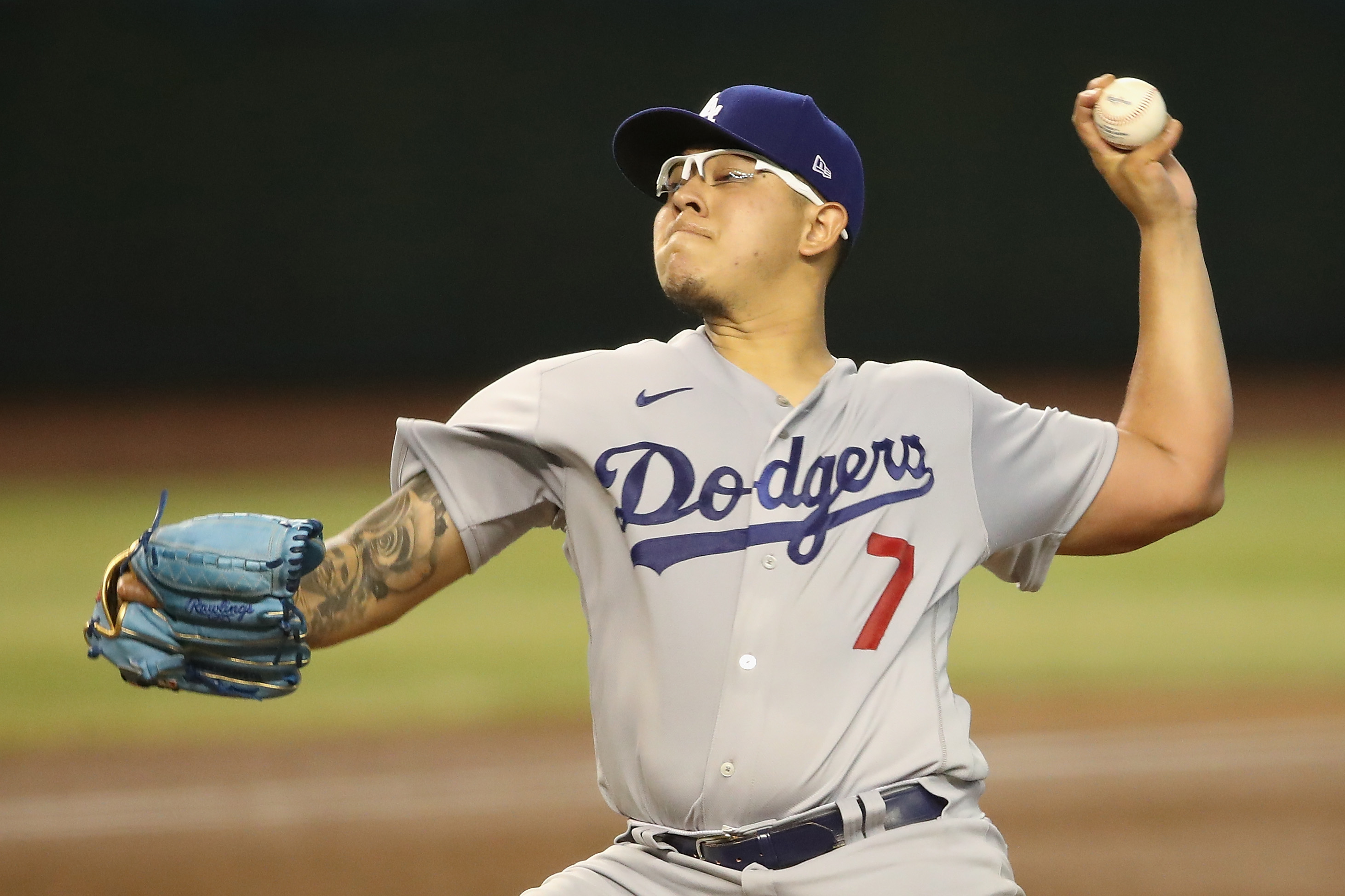 Starting pitcher Julio Urias #7 of the Los Angeles Dodgers throws a pitch against the Arizona Diamondbacks during the second inning of the MLB game at Chase Field on August 01, 2020 in Phoenix, Arizona.