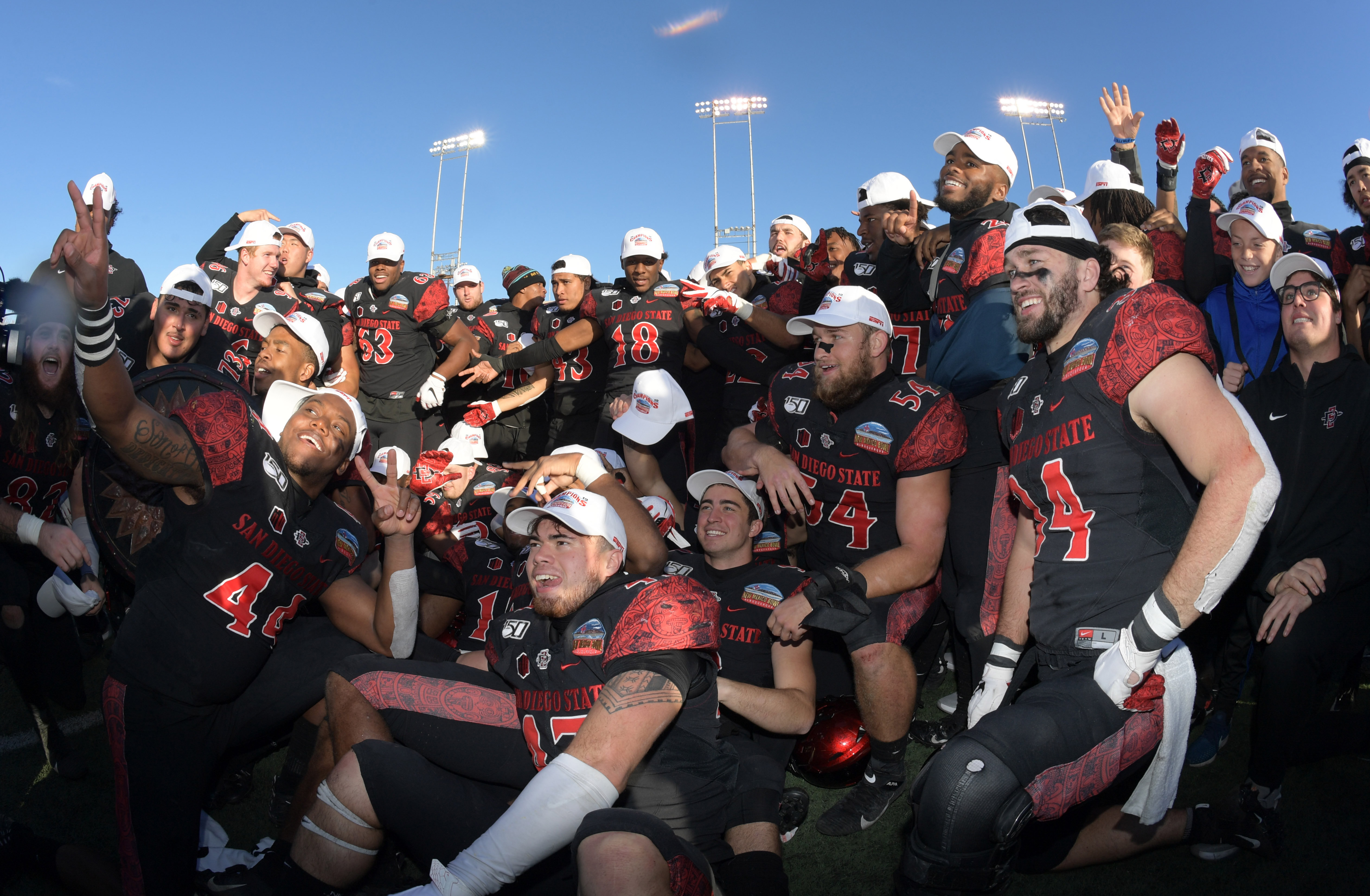 San Diego State players celebrate after the New Mexico Bowl against Central Michigan at Dreamstyle Stadium. San Diego State defeated Central Michigan 48-11.