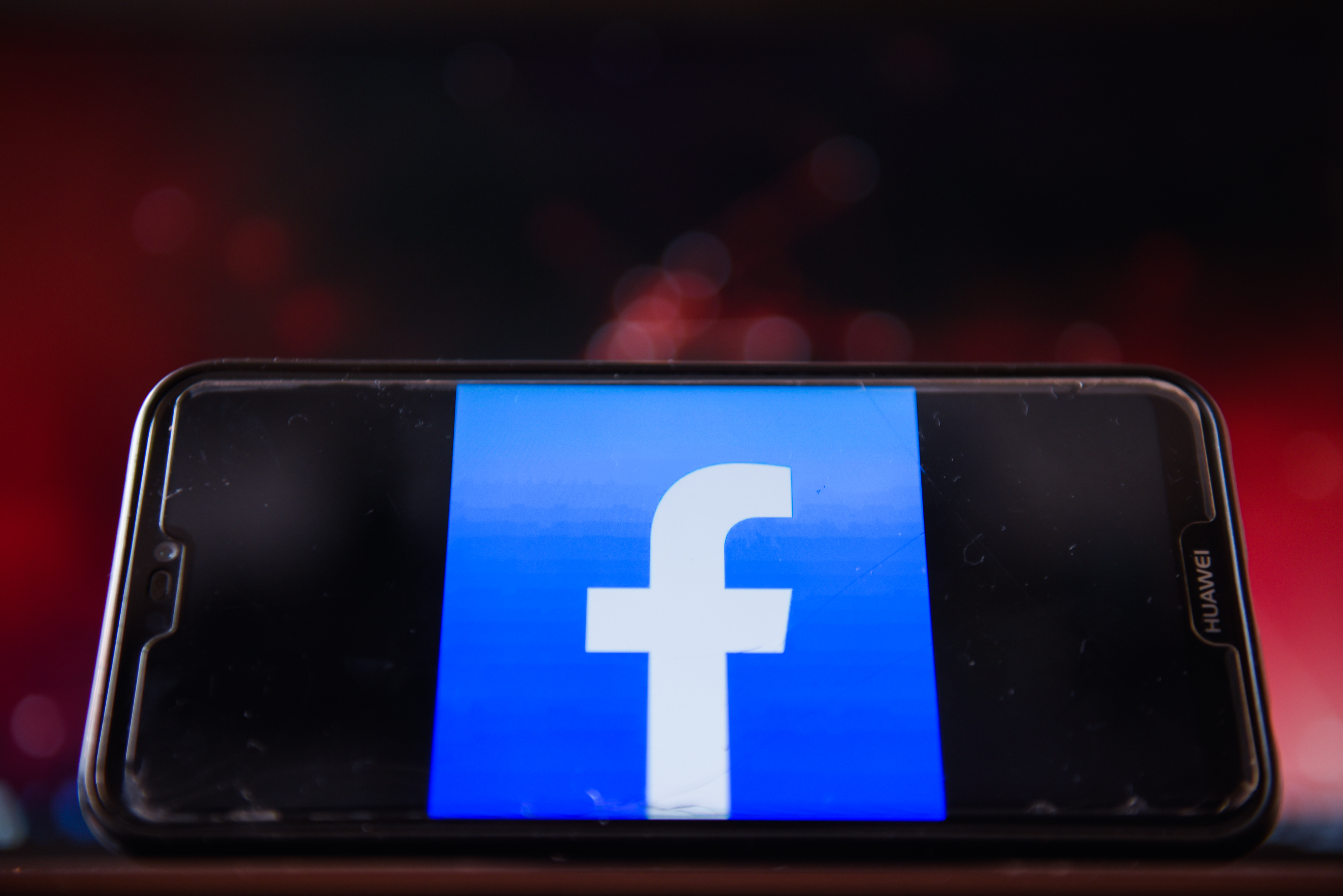 In this photo illustration, a Facebook logo is displayed on...
