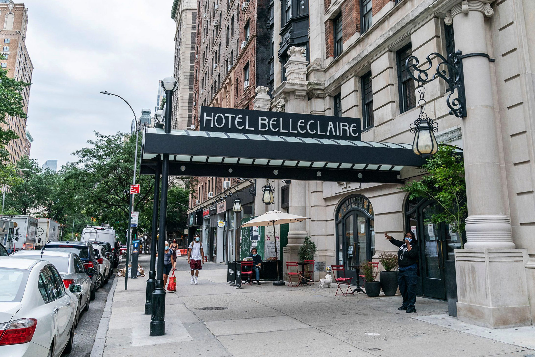 """The entrance to a hotel with a sign that reads """"Hotel Belleclaire."""""""