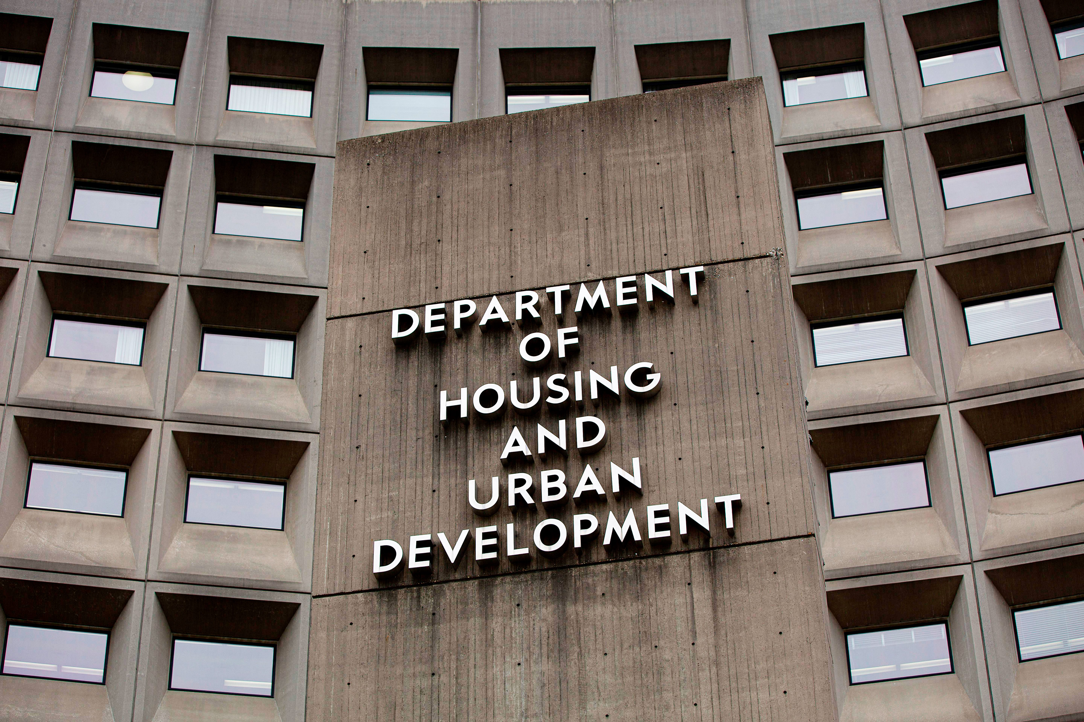 An exterior view of a concrete office building with the words Department of Housing and Urban Development. The building is the headquarters of HUD, run by Ben Carson under the Trump administration.