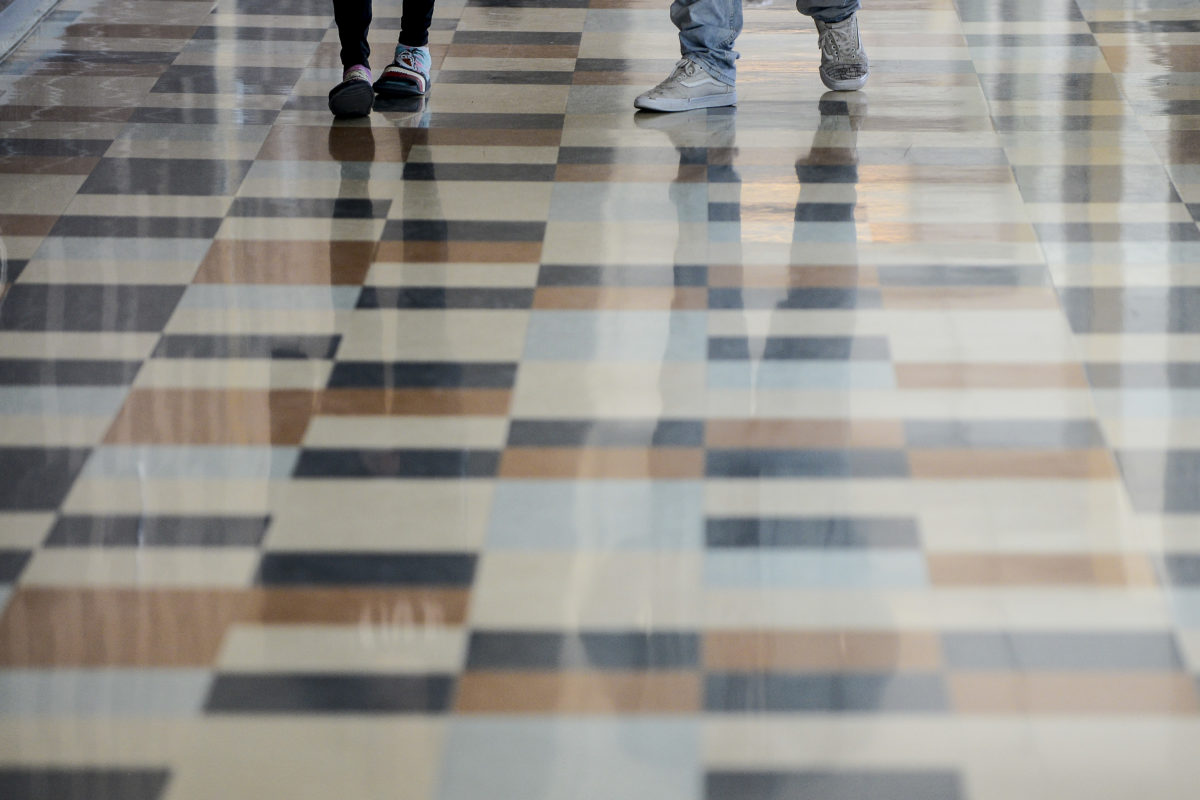 Students walk through the hall at Adams City High School Monday, Feb. 4, 2019 in Commerce City.