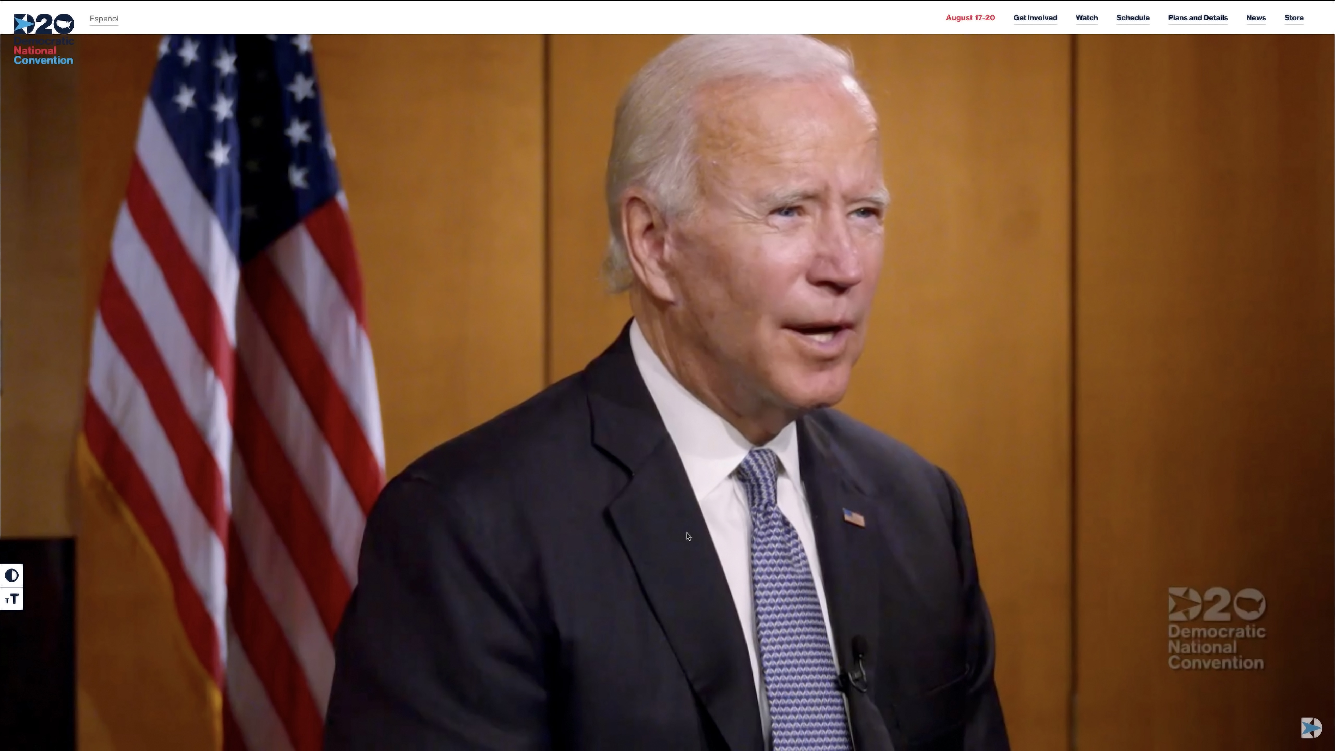 Presumptive Democratic presidential nominee former Vice President Joe Biden wears a suit and tie sitting in front of an American flag on a conference call during the virtual convention on August 17, 2020.