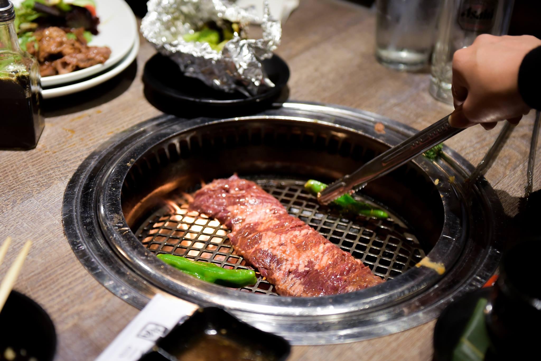 Grilling meats at Gyu-Kaku