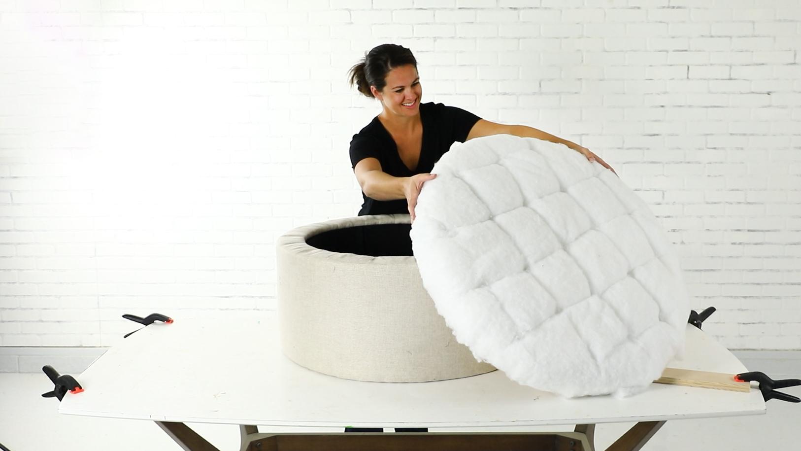 Jenn Largesse upholsters a round storage ottoman.