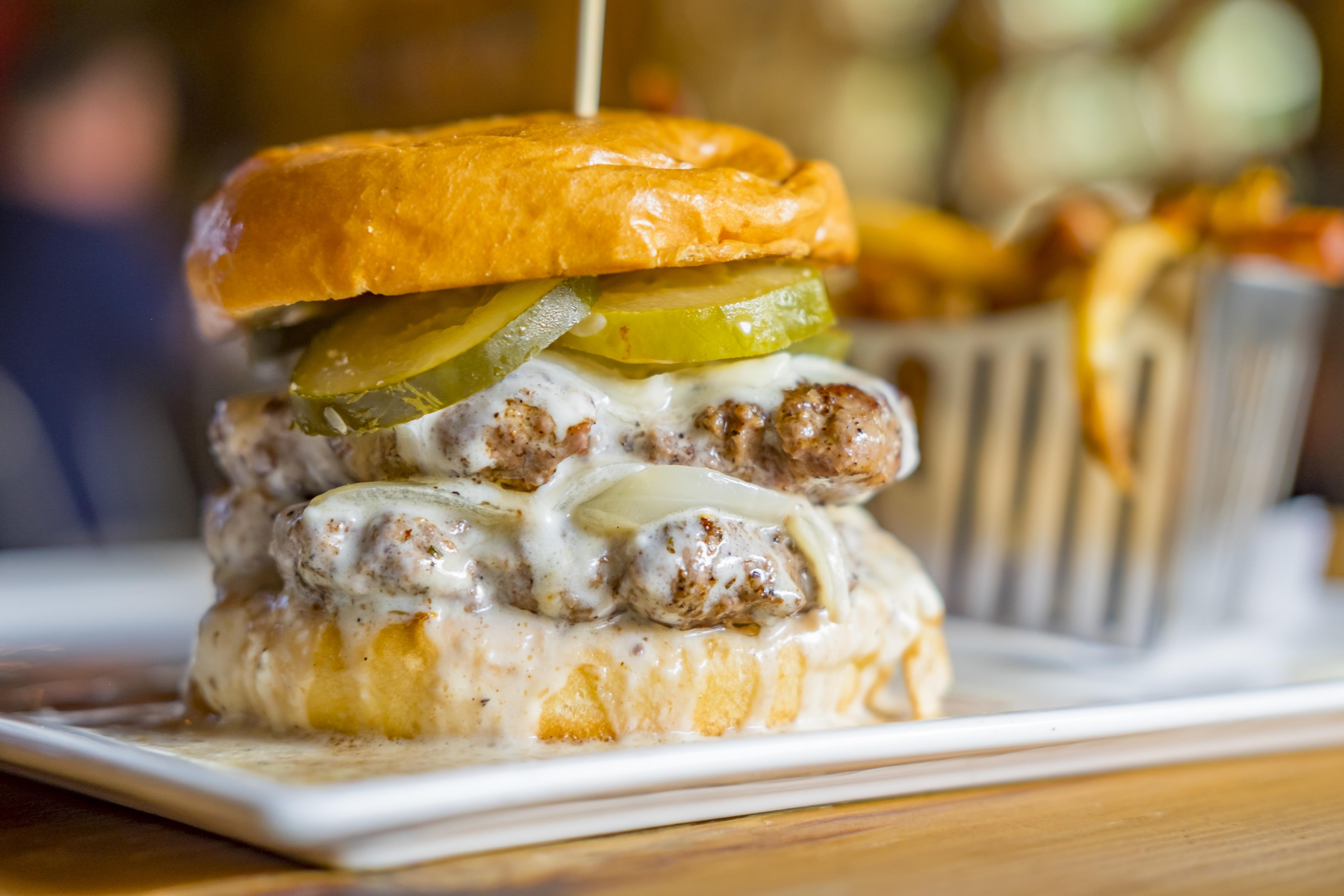 The double cheeseburger with pickles at Hobnob Atlanta