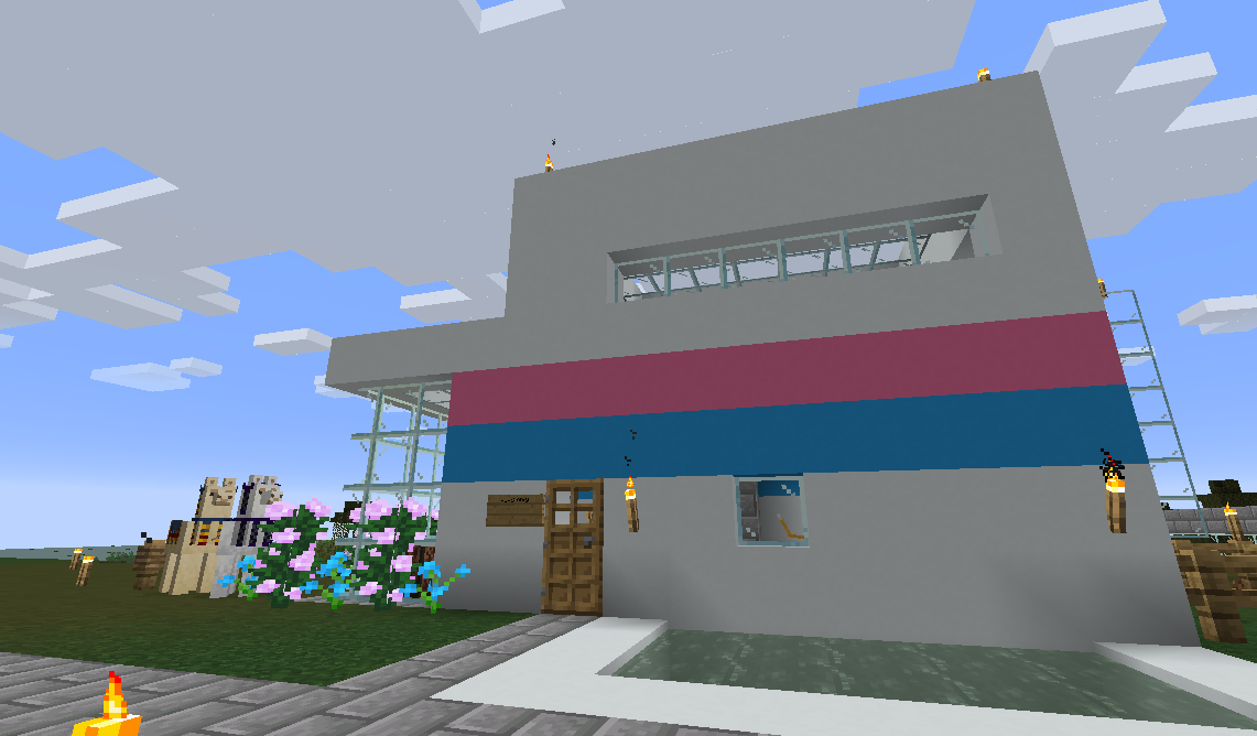 A white lofted Minecraft house with a pink and blue stripe down the middle