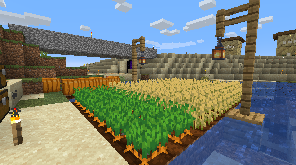 A screenshot of a farm area in Minecraft with Wheat, Carrots, and Pumpkins