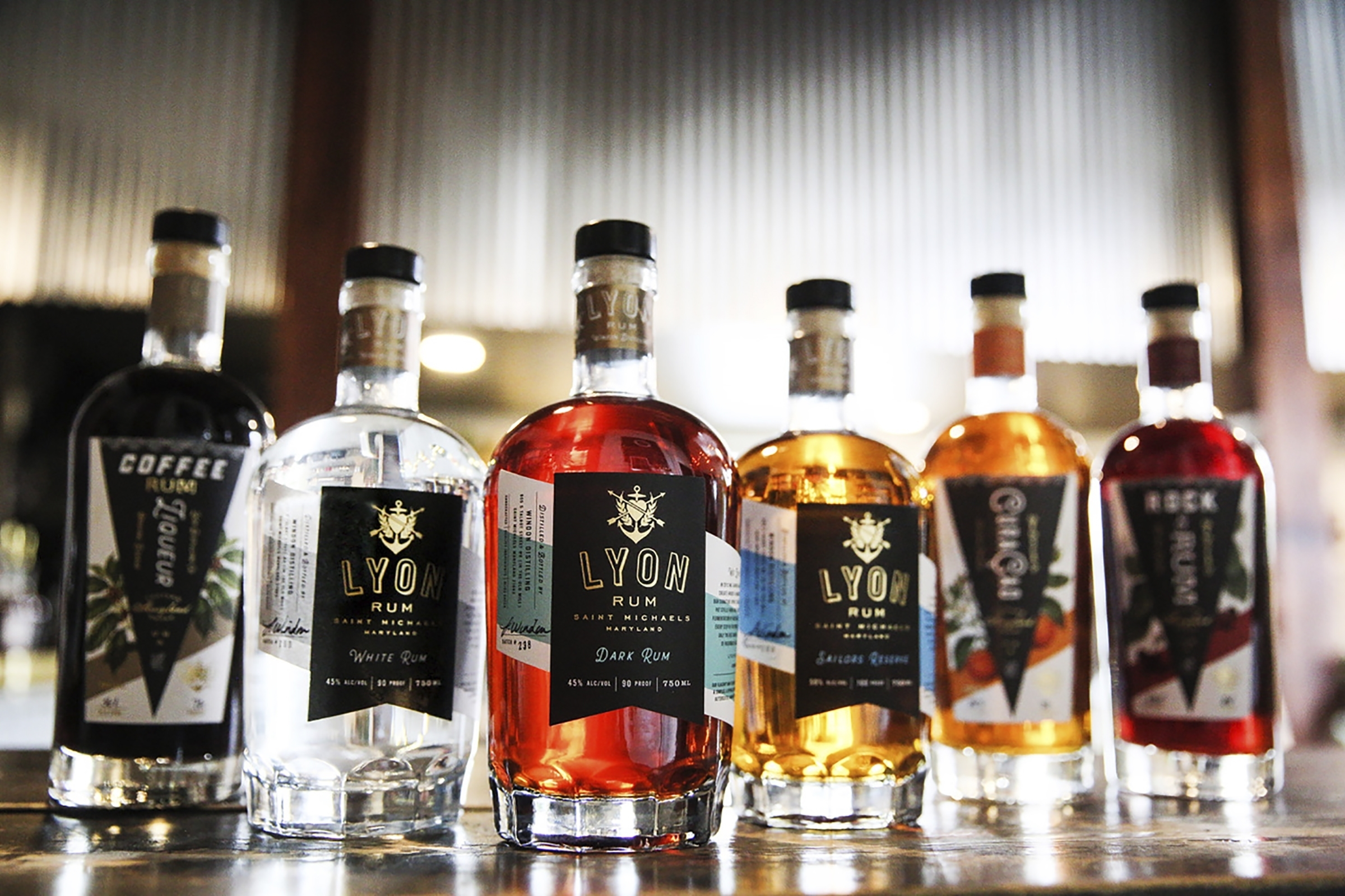 Bottles of alcohol, including Lyon rum, are displayed. Windon Distilling, a Maryland-based producer of Lyon Rum, is among the many craft distillers taking an economic hit from the COVID-19 pandemic.