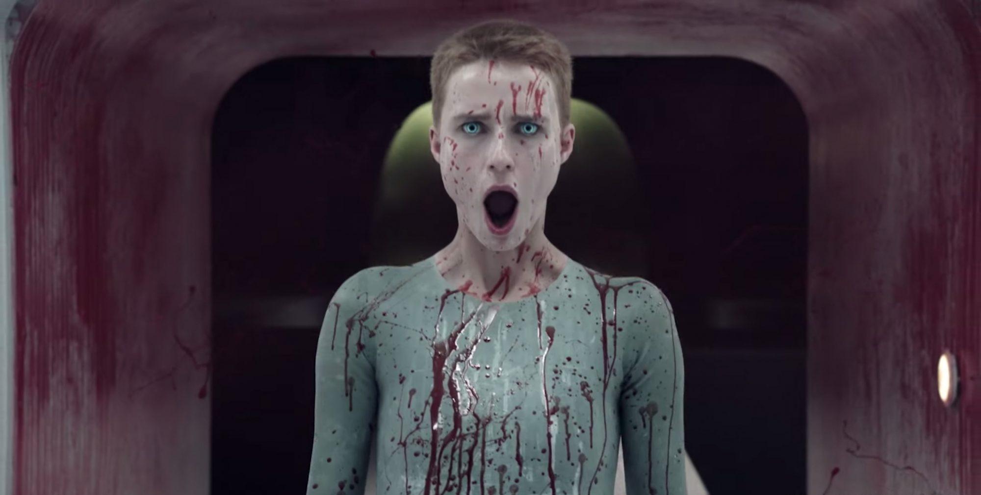 a bloodied woman screams
