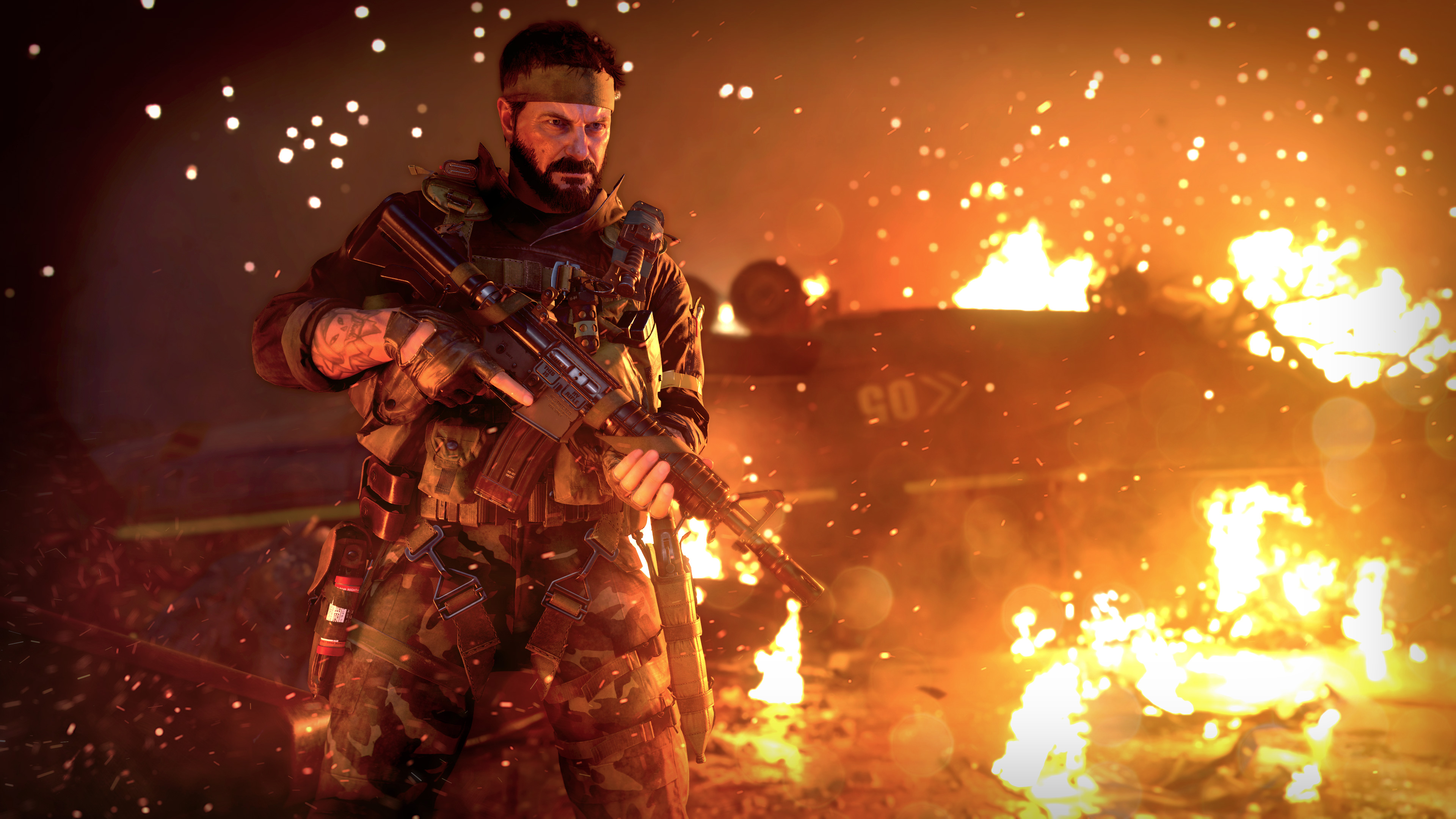 Woods stands in front of a fire in Black Ops Cold War