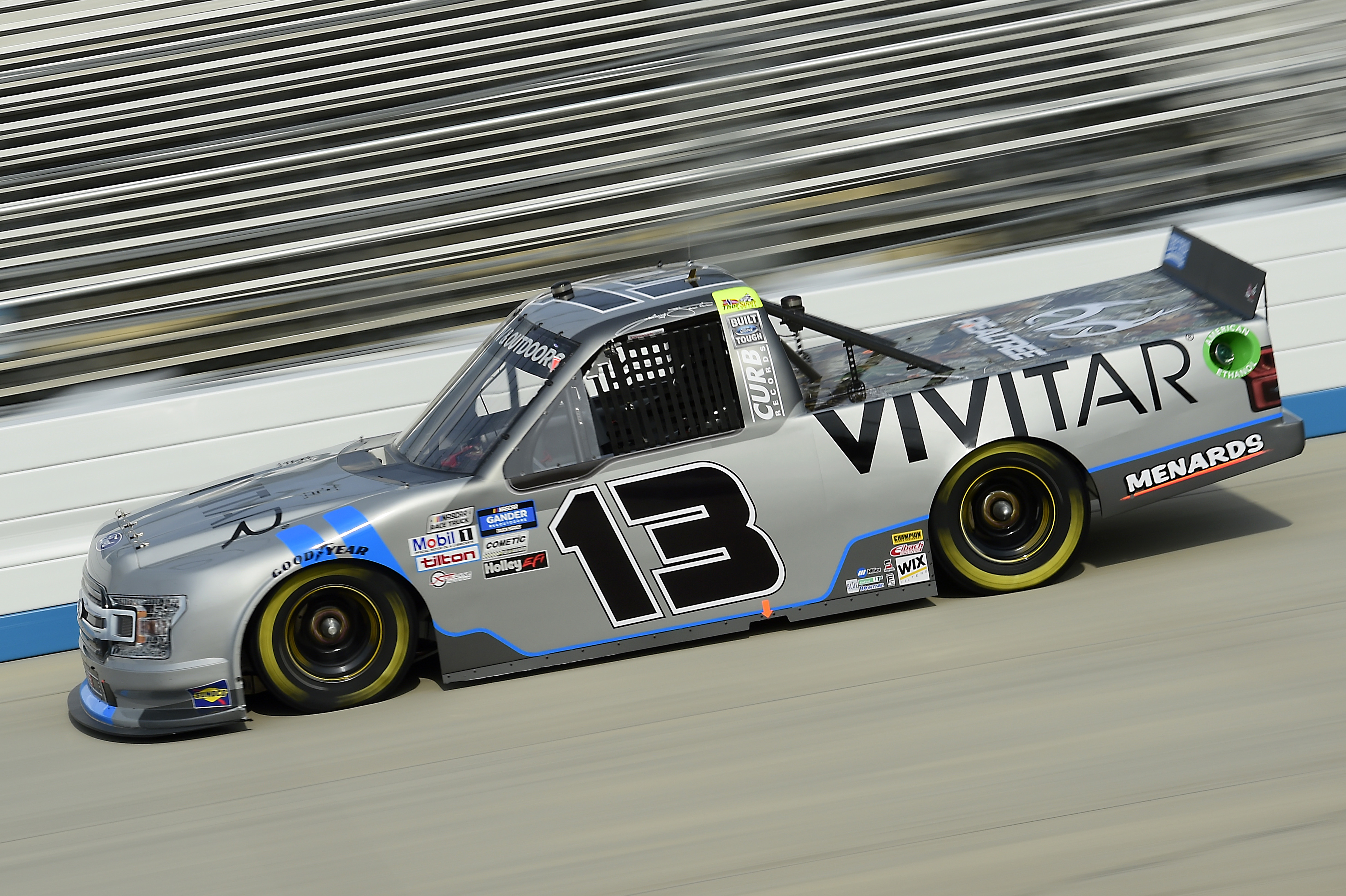 Johnny Sauter, driver of the #13 Vivitar Ford, drives during the NASCAR Gander RV & Outdoors Truck Series KDI Office Technology 200 at Dover International Speedway on August 21, 2020 in Dover, Delaware.