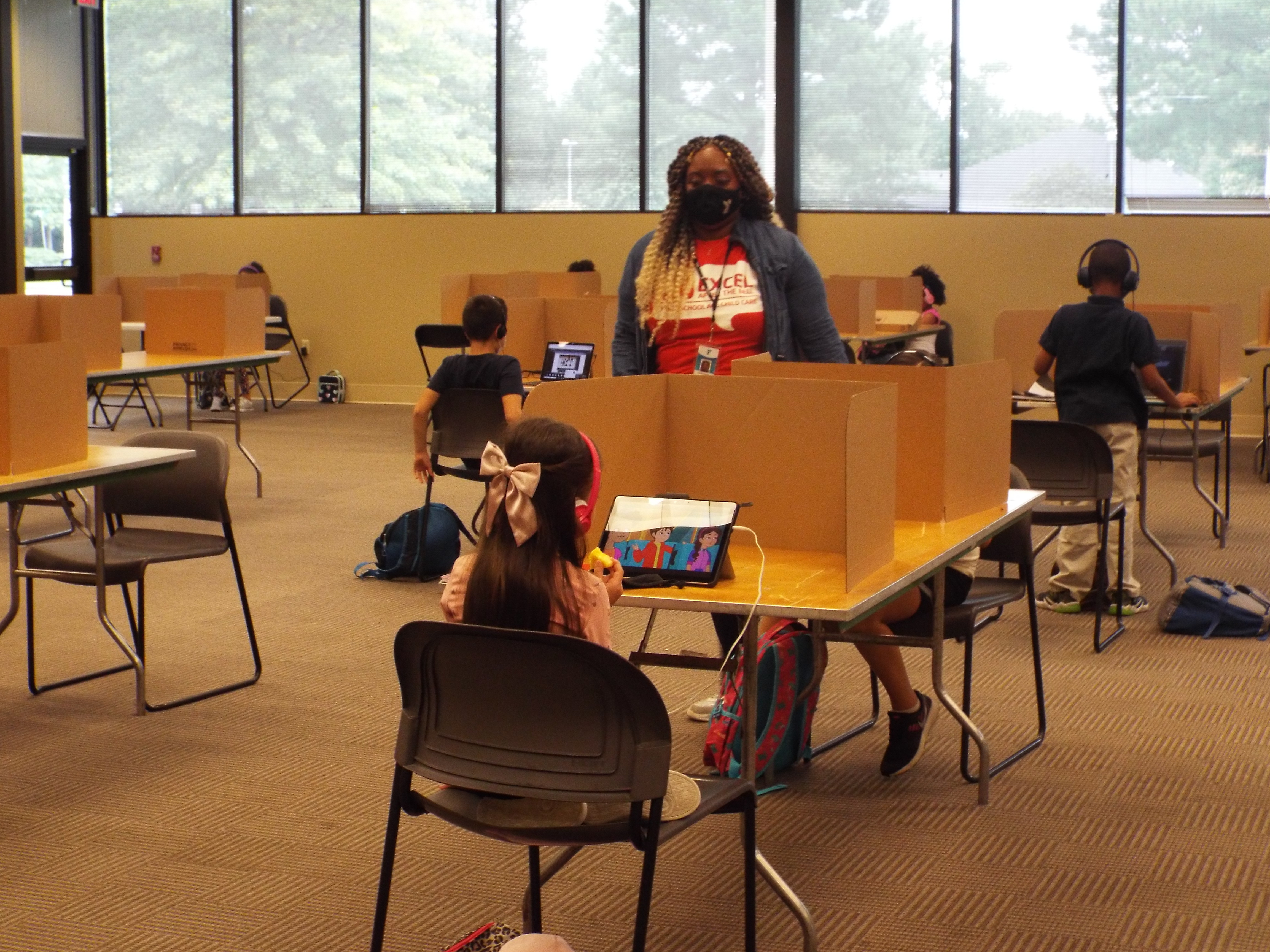 Shelby County Schools students log in remotely from the YMCA's virtual learning center on the first day of school.