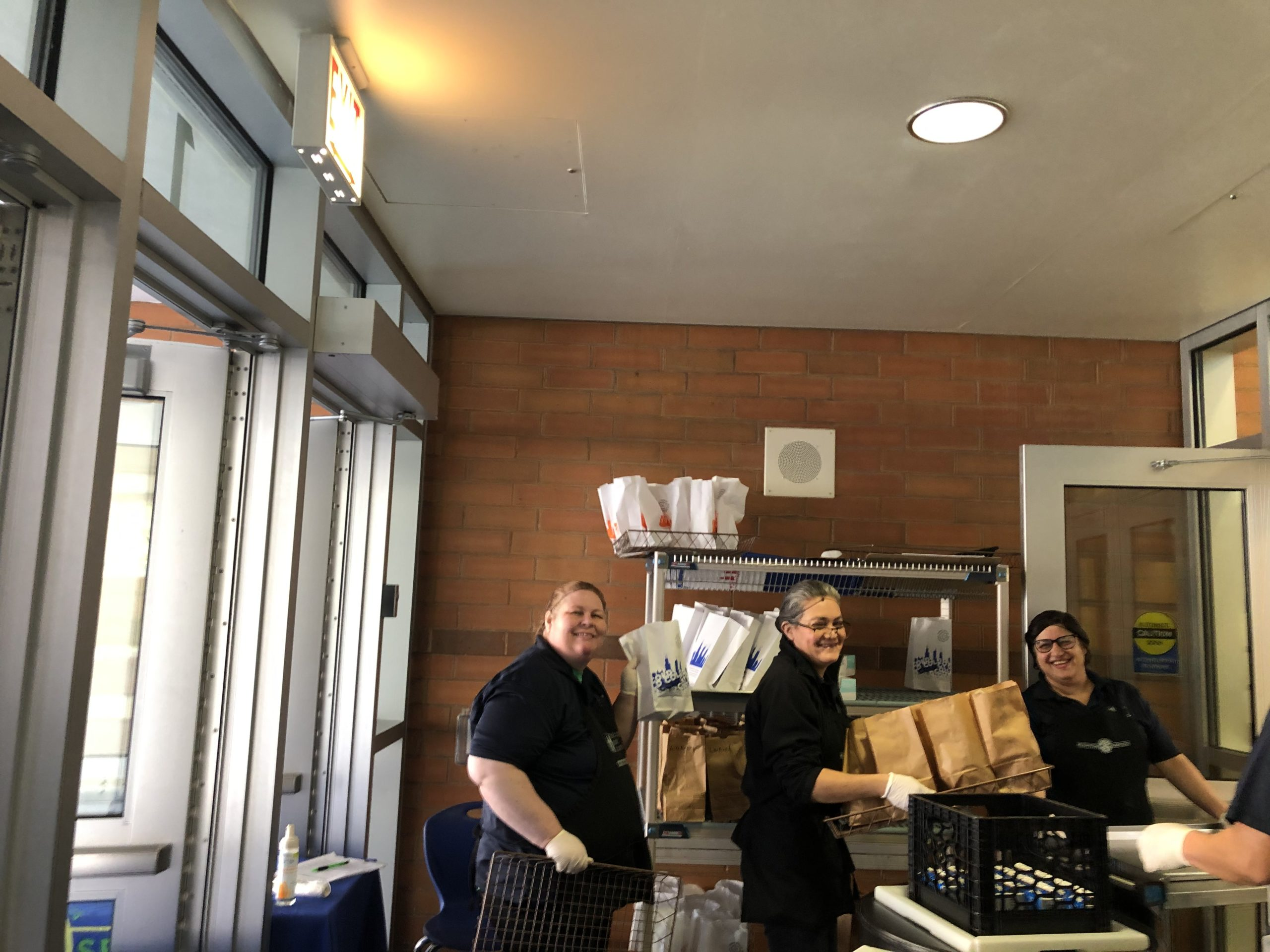 The lunchroom staff at Federico Garcia Lorca Elementary pose on the first week of food distribution in Chicago. The district had distributed 13 million meals as of June 1.
