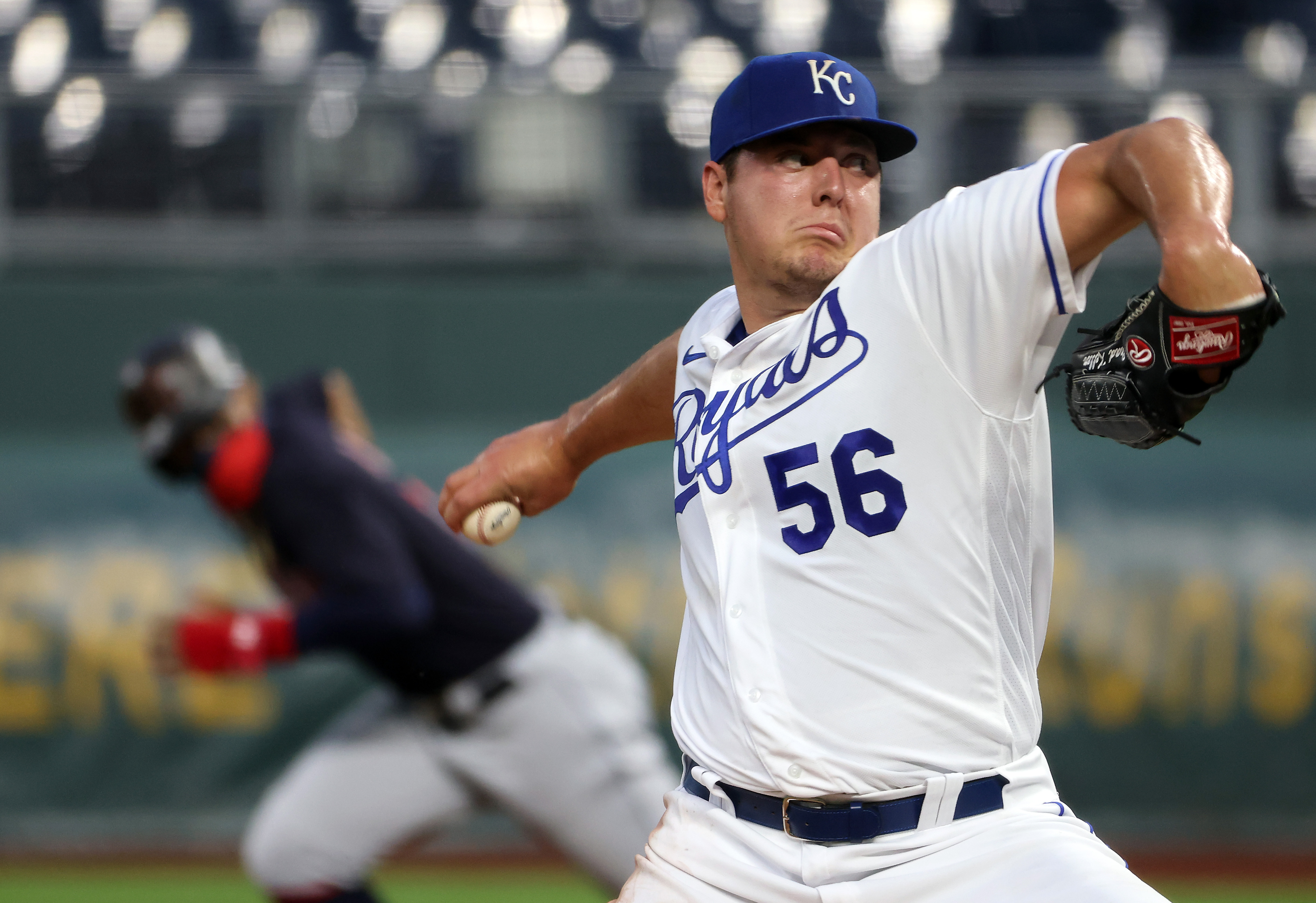 Starting pitcher Brad Keller #56 of the Kansas City Royals pitches as Francisco Lindor #12 of the Cleveland Indians breaks for second during the 1st inning of the game at Kauffman Stadium on August 31, 2020 in Kansas City, Missouri.