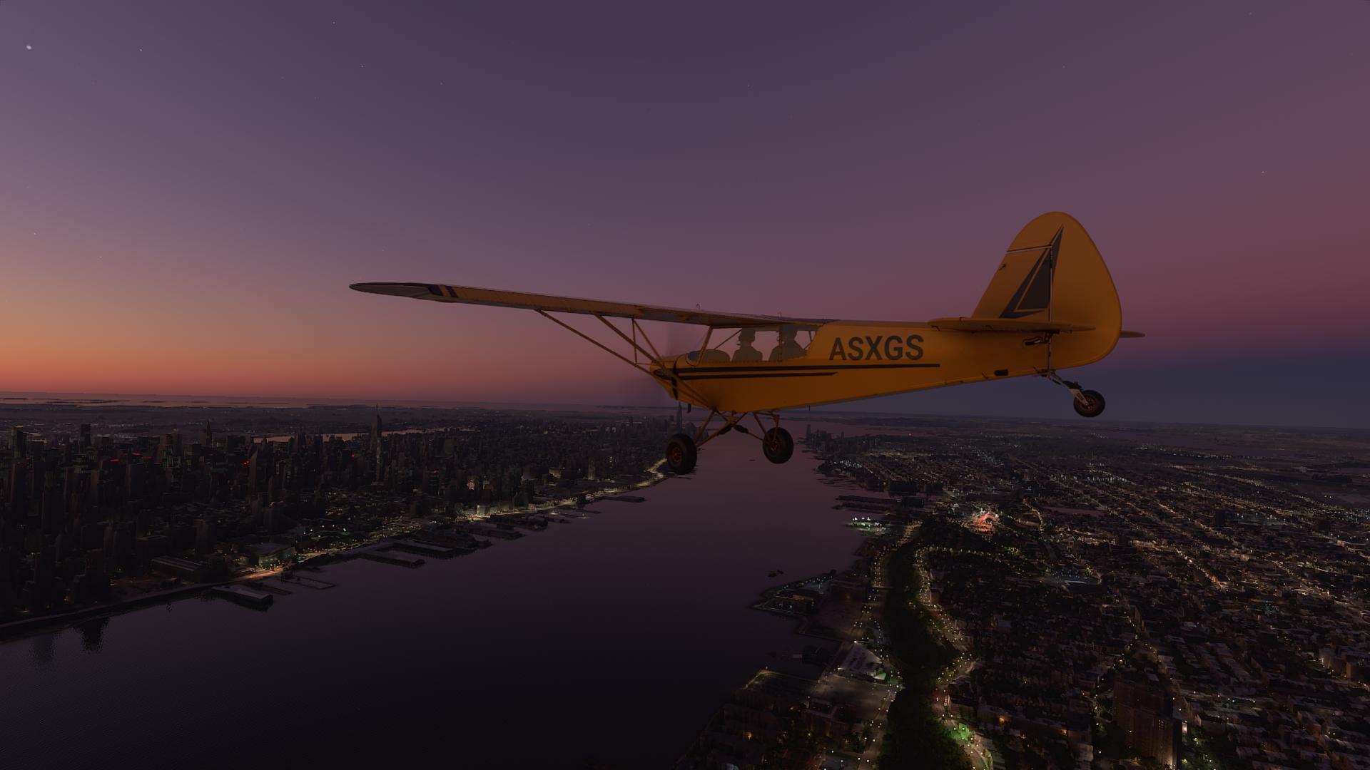 A yellow plane flies in dusk over New York City in Microsoft Flight Simulator