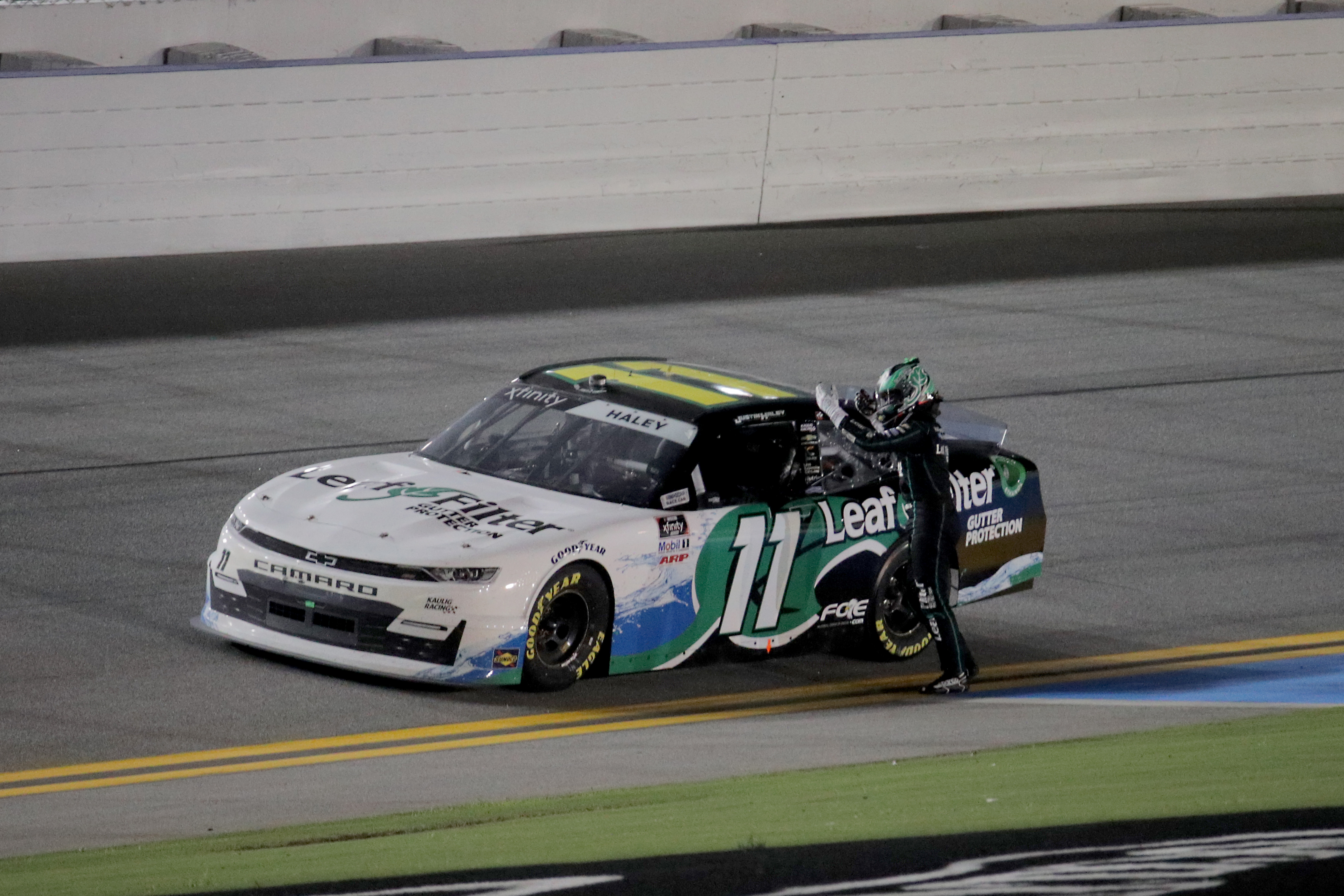 Justin Haley, driver of the #11 LeafFilter Gutter Protection Chevrolet, celebrates after winning the NASCAR Xfinity Series Wawa 250 Powered by Coca-Cola at Daytona International Speedway on August 28, 2020 in Daytona Beach, Florida.