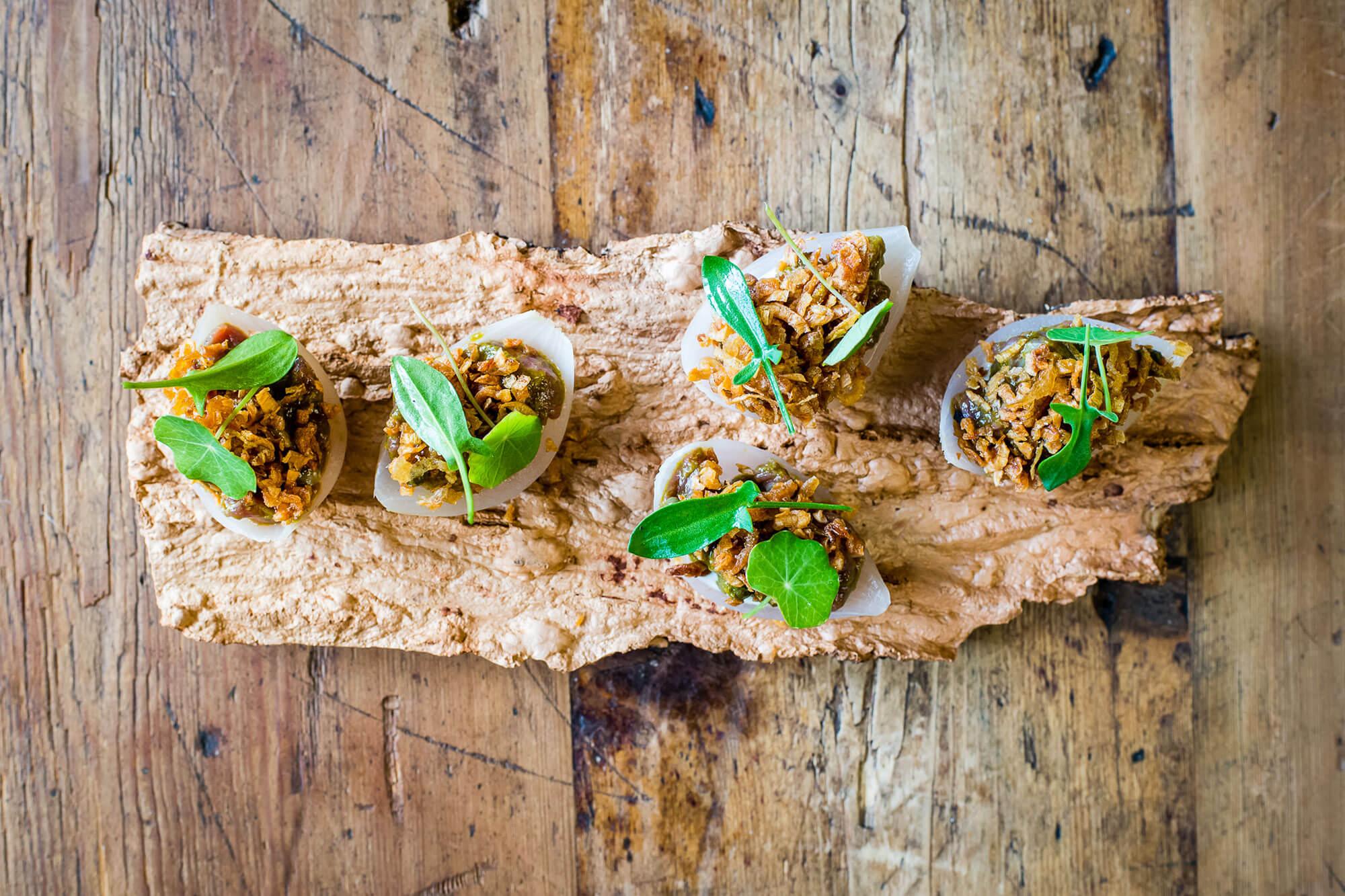A nasturtium cracker at London tasting menu The Dairy in Clapham