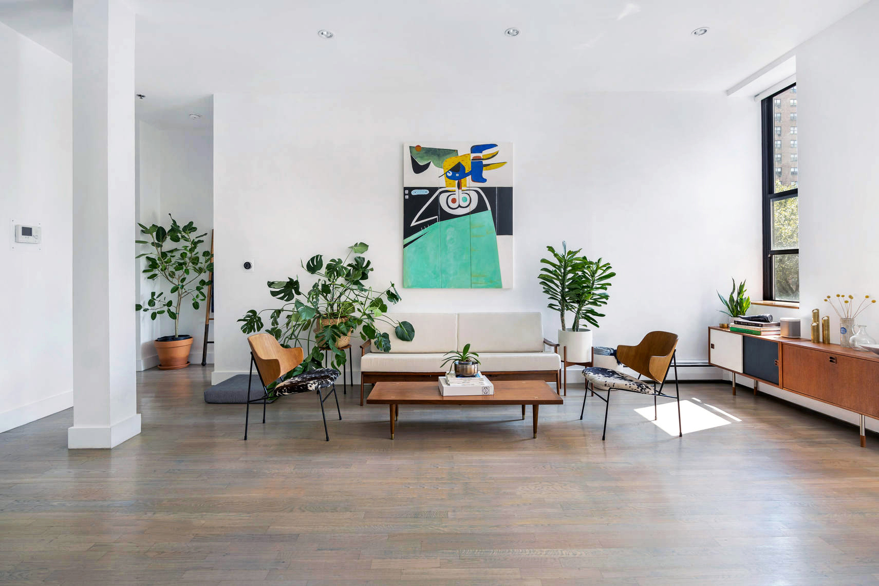 A living area with hardwood floors and 10.4-foot ceilings inside a Clinton Hill, Brooklyn, co-op building.