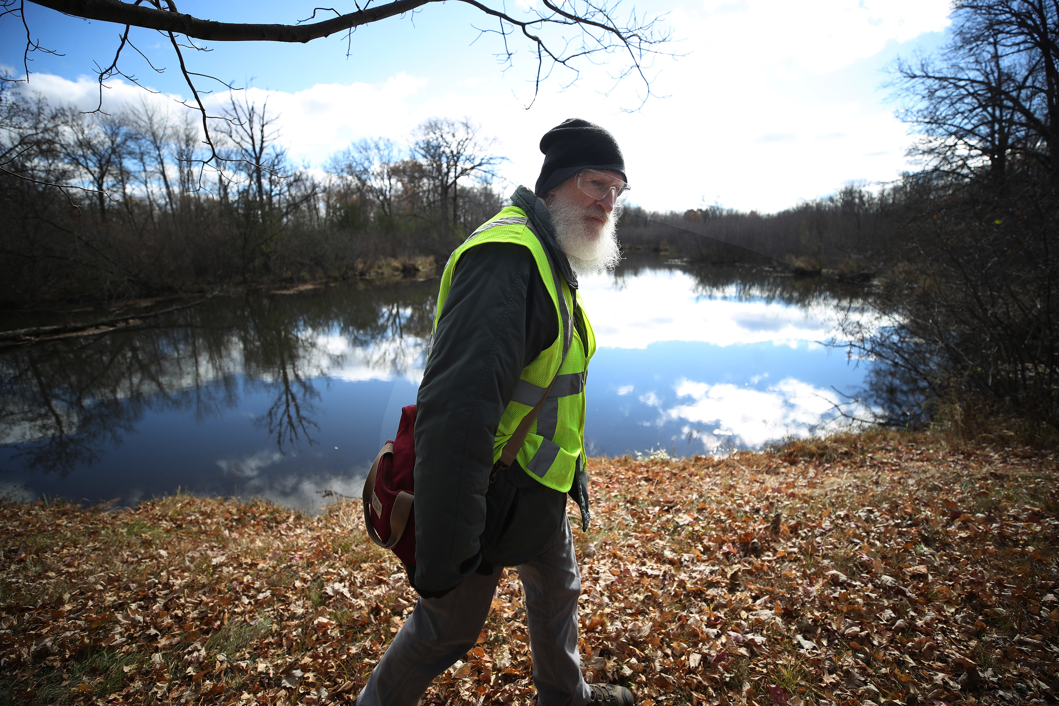 Greg Niemuth of Eau Claire searched along the Yellow river around 15 avenue near highway 25 just north of town for missing 13-year-old Jayme Closs Tuesday October 23, 2018 in Barron, WIS. ] Jerry Holt • Jerry.holt@startribune.com