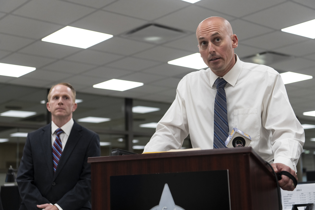 Area Five Commander Eric Winstrom, right, updates reporters on the slaying of a 18-year-old Walgreens employee on Sunday, Tuesday, Sept. 8, 2020.