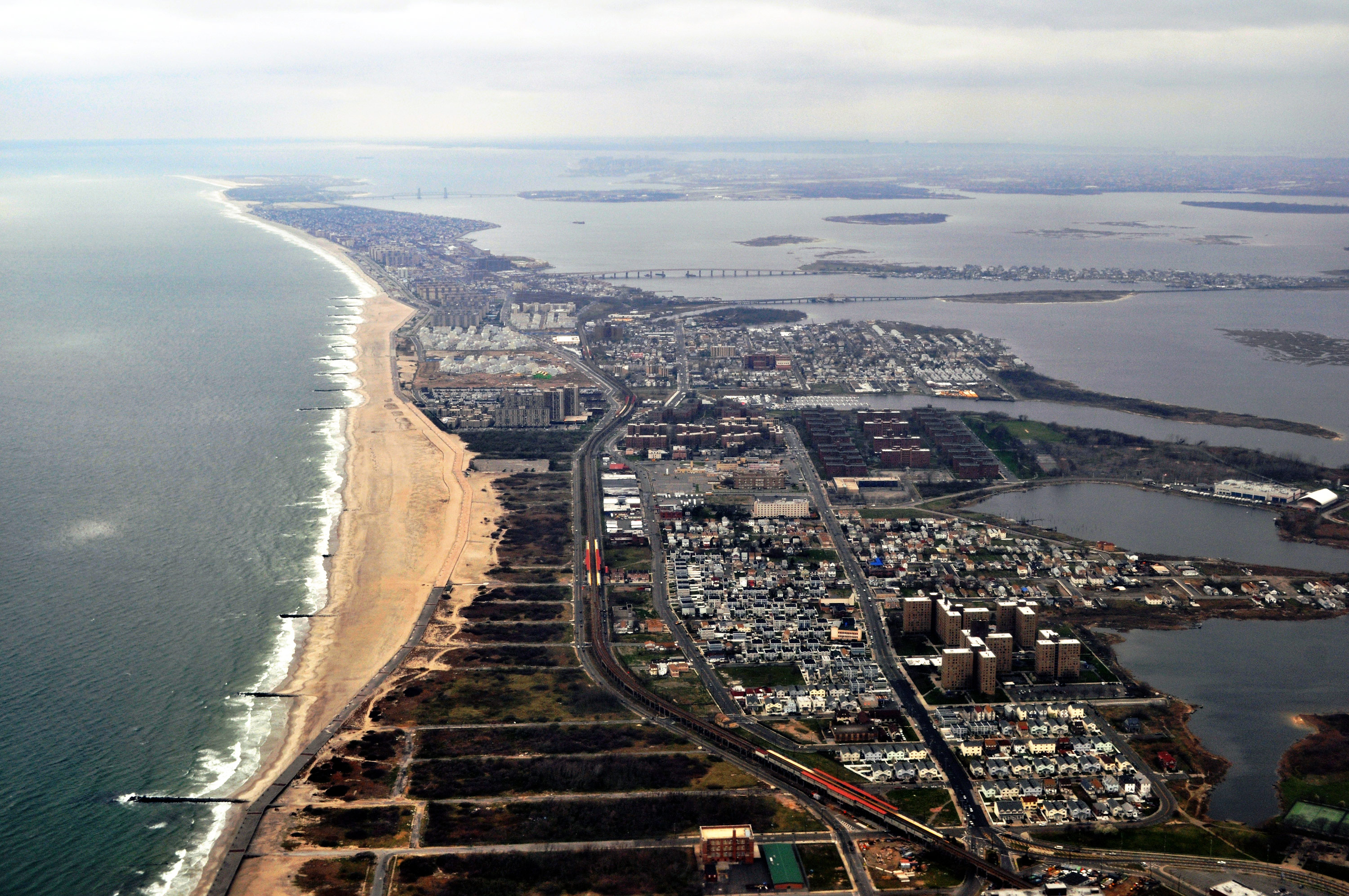 A birds-eye view of the Rockaway peninsula sandwiched between Jamaica Bay and the Atlantic.