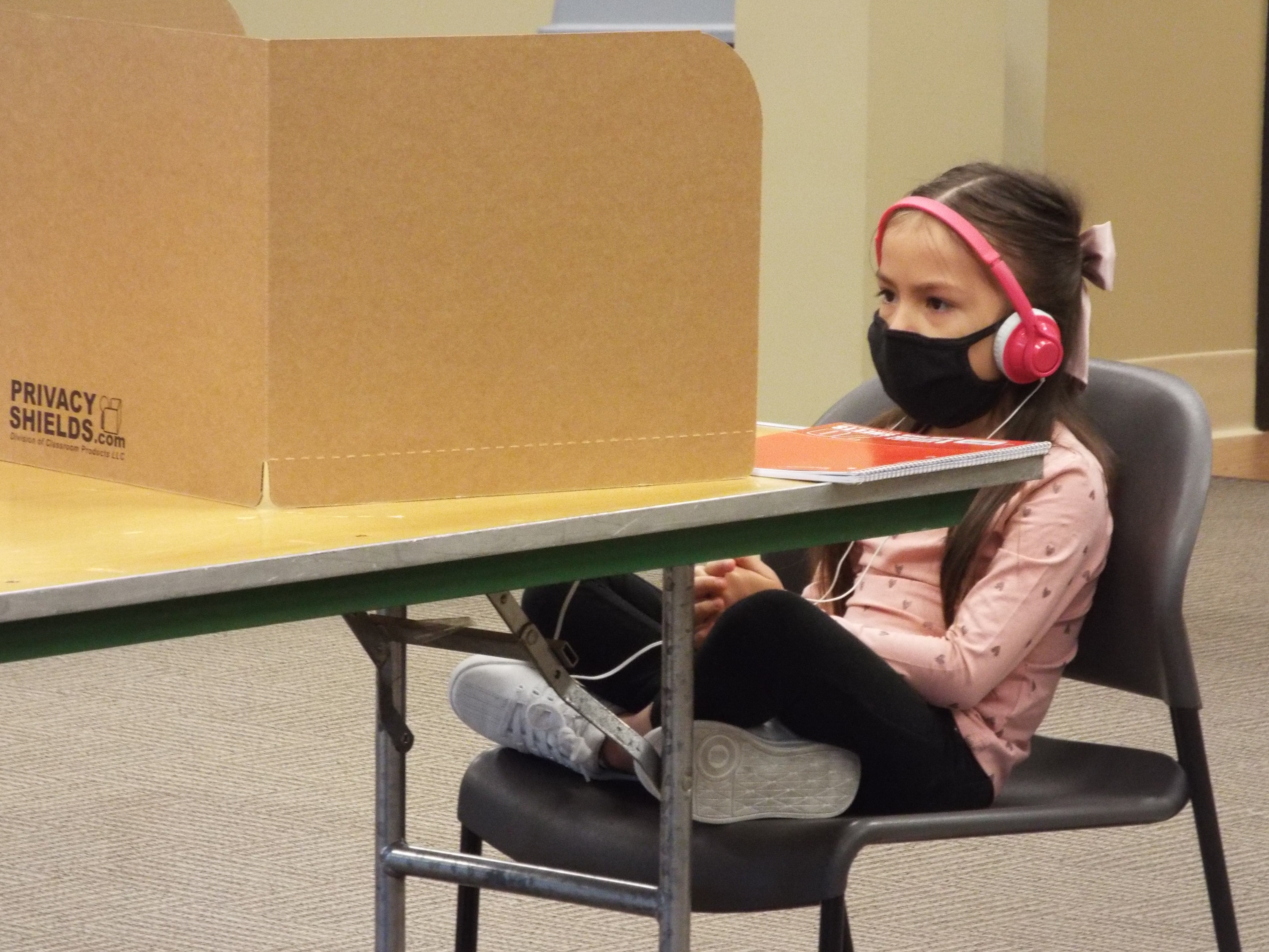 A Shelby County Schools student works remotely from the YMCA's virtual learning center on the first day of school.