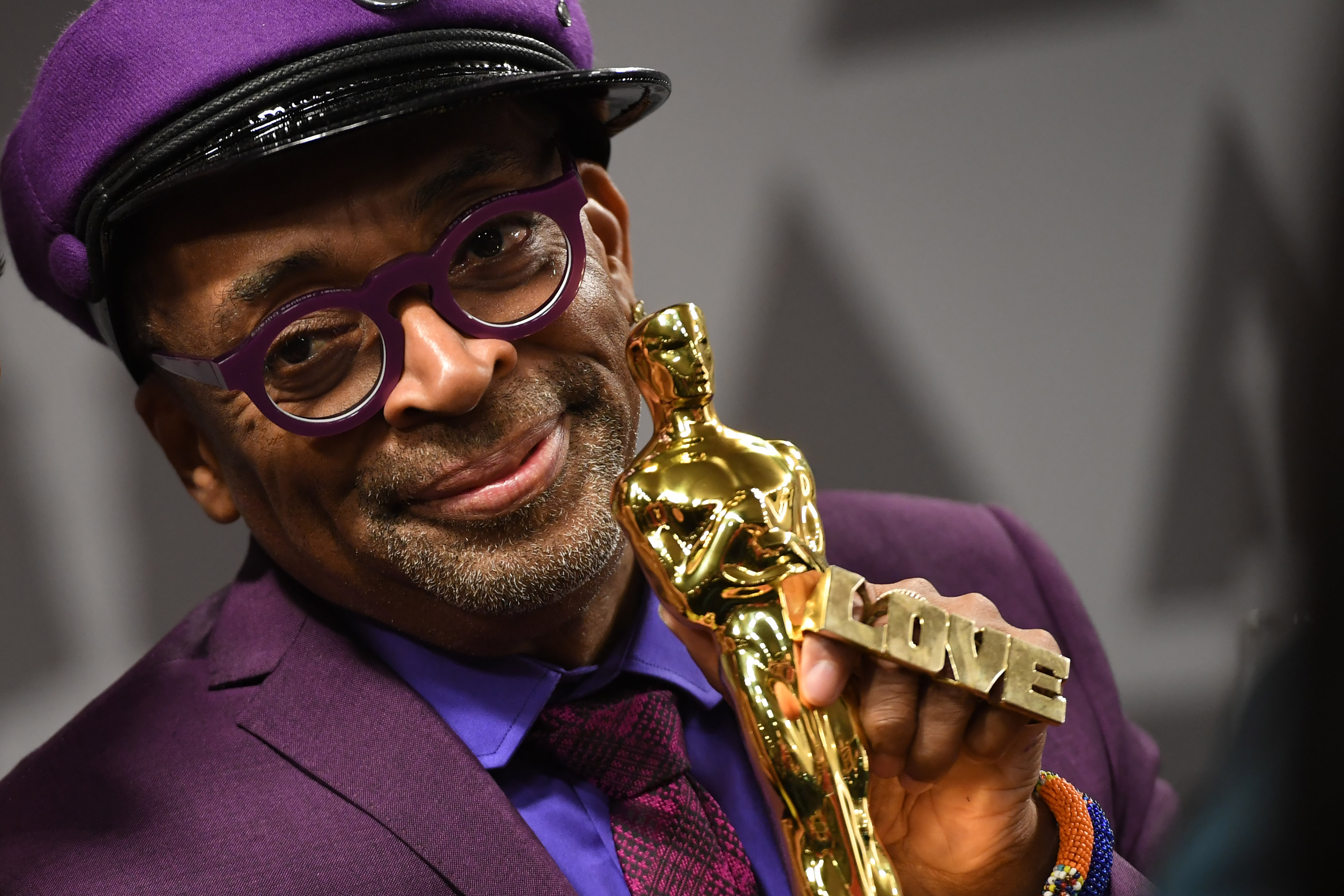 Spike Lee holds his Oscar statuette.