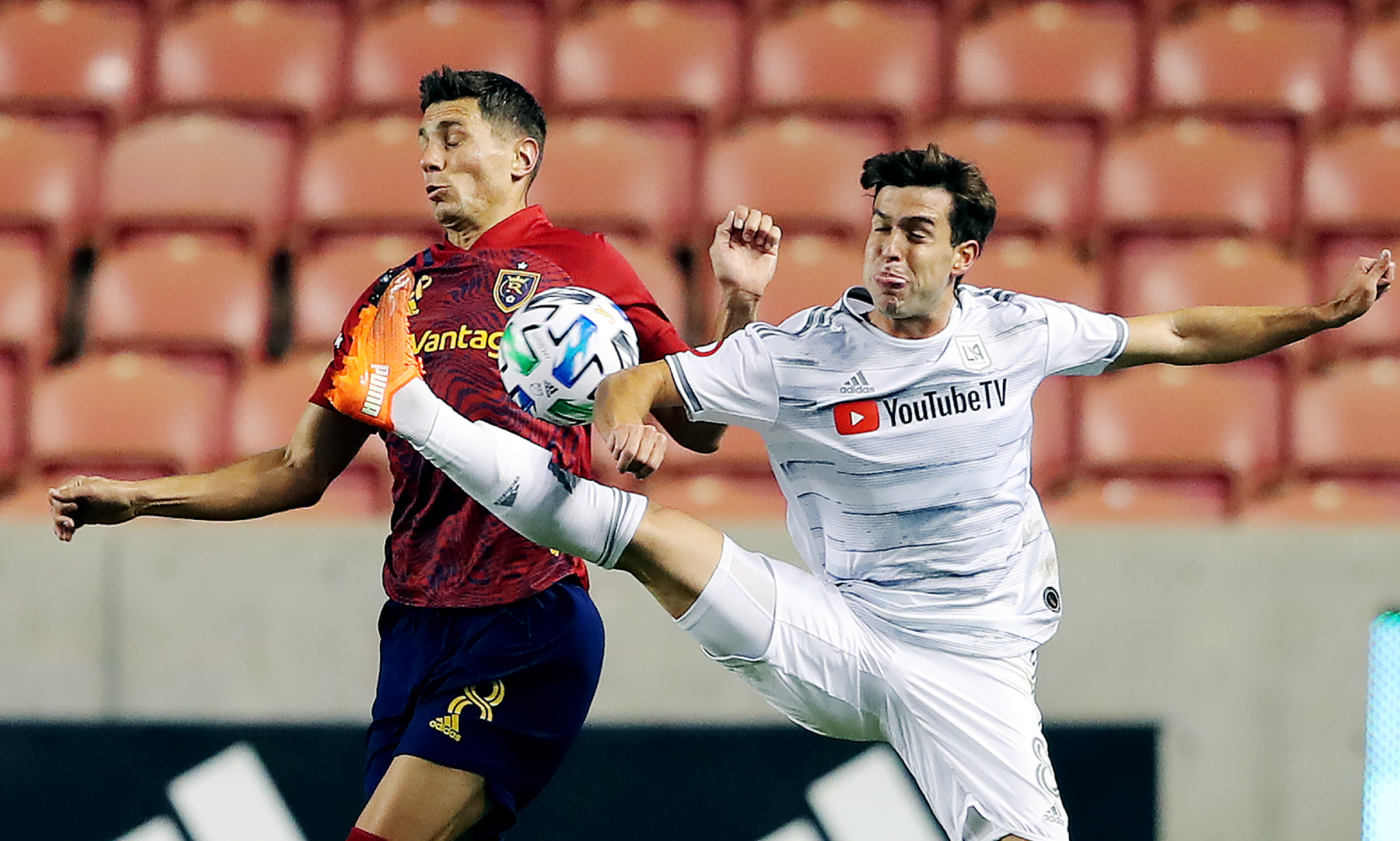 Real Salt Lake midfielder Damir Kreilach (8) and Los Angeles FC midfielder Francisco Ginella (8) battle for the ball as Real Salt Lake and Los Angeles FC play an MLS game at Rio Tinto Stadium in Sandy on Wednesday, Sept. 9, 2020.