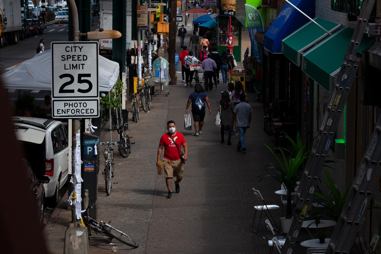 People in Corona, Queens, walk along Roosevelt Avenue, Sept. 1, 2020.