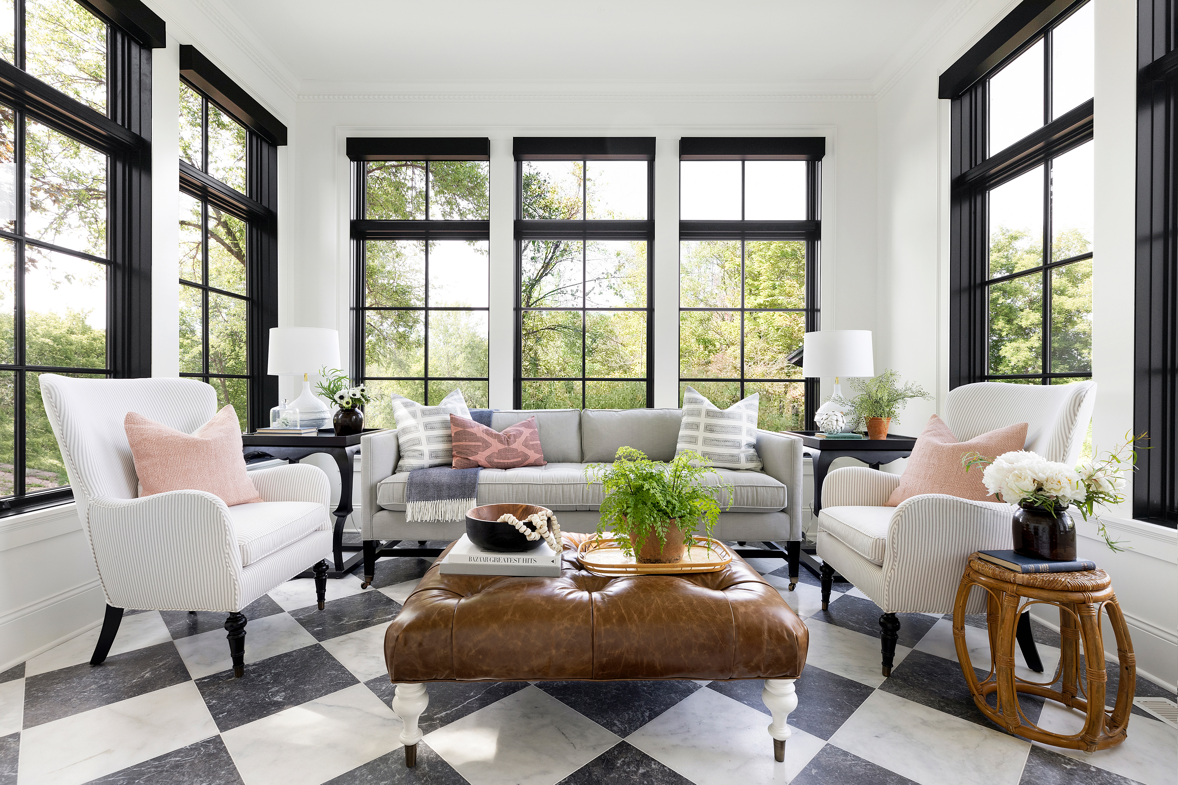 Sunroom with a sofa and chairs.