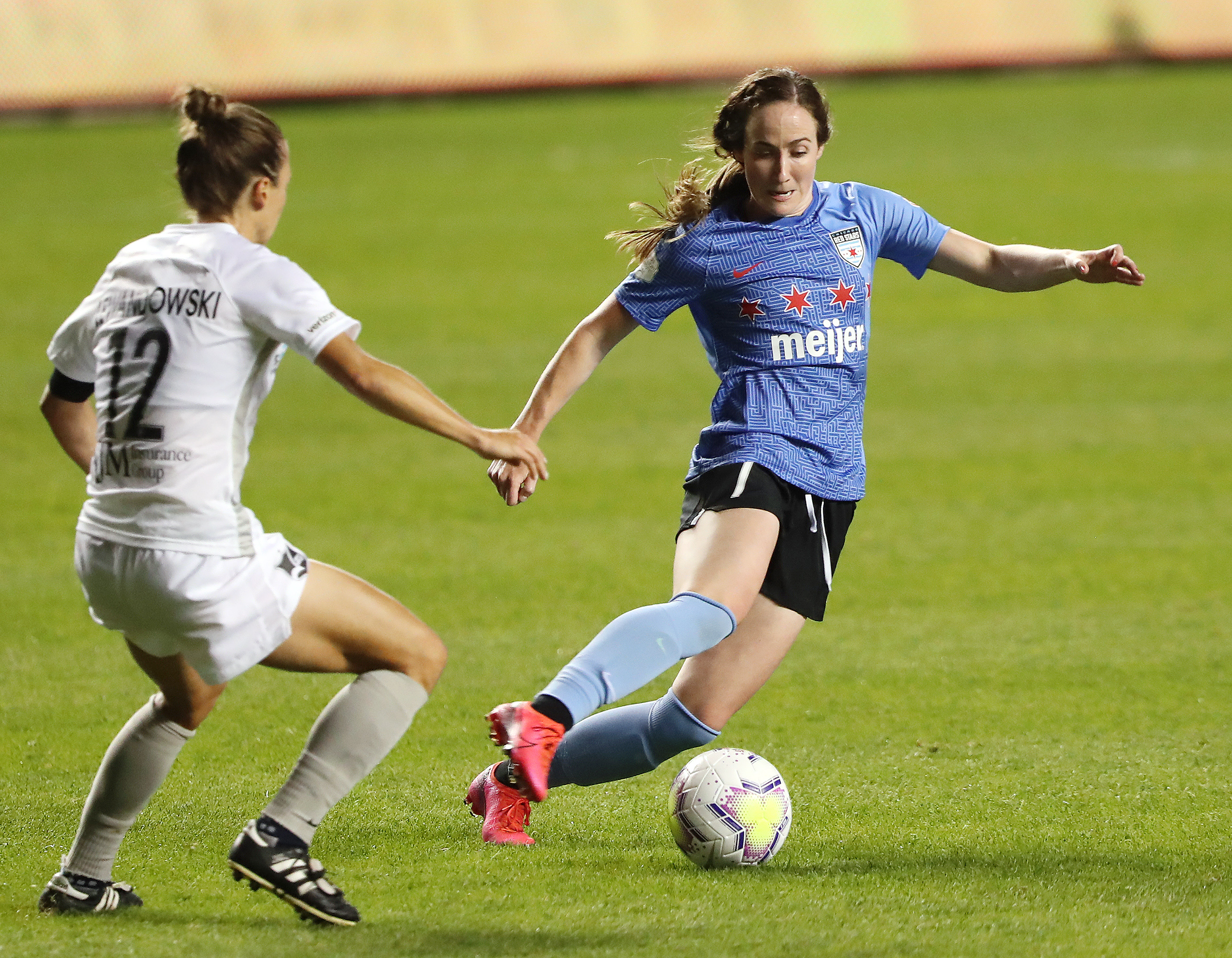 Chicago Red Stars midfielder Michele Vasconcelos (7) makes a move to avoid Sky Blue FC defender Gina Lewandowski (12) as Sky Blue FC and Chicago Red Stars play in the semifinals of the NWSL Challenge Cup at Rio Tinto Stadium in Sandy on Wednesday, July 22, 2020. Chicago won 3-2.