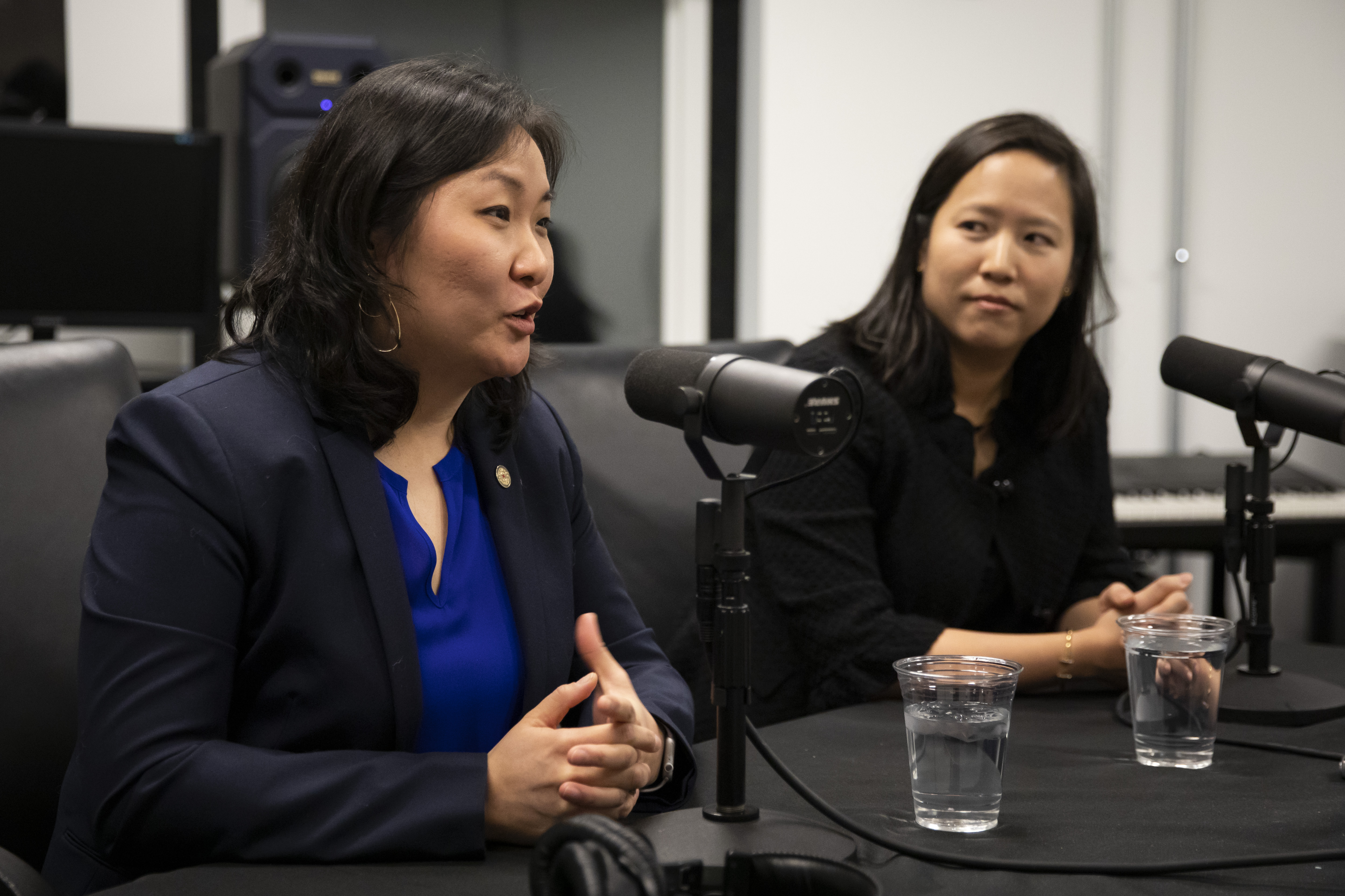 The city's Chief Financial Officer Jennie Huang Bennett looks on as Budget Director Susie Park speaks during an interview with reporter Fran Spielman at the Chicago Sun-Times, Friday morning, Dec. 13, 2019. | Ashlee Rezin Garcia/Sun-Times