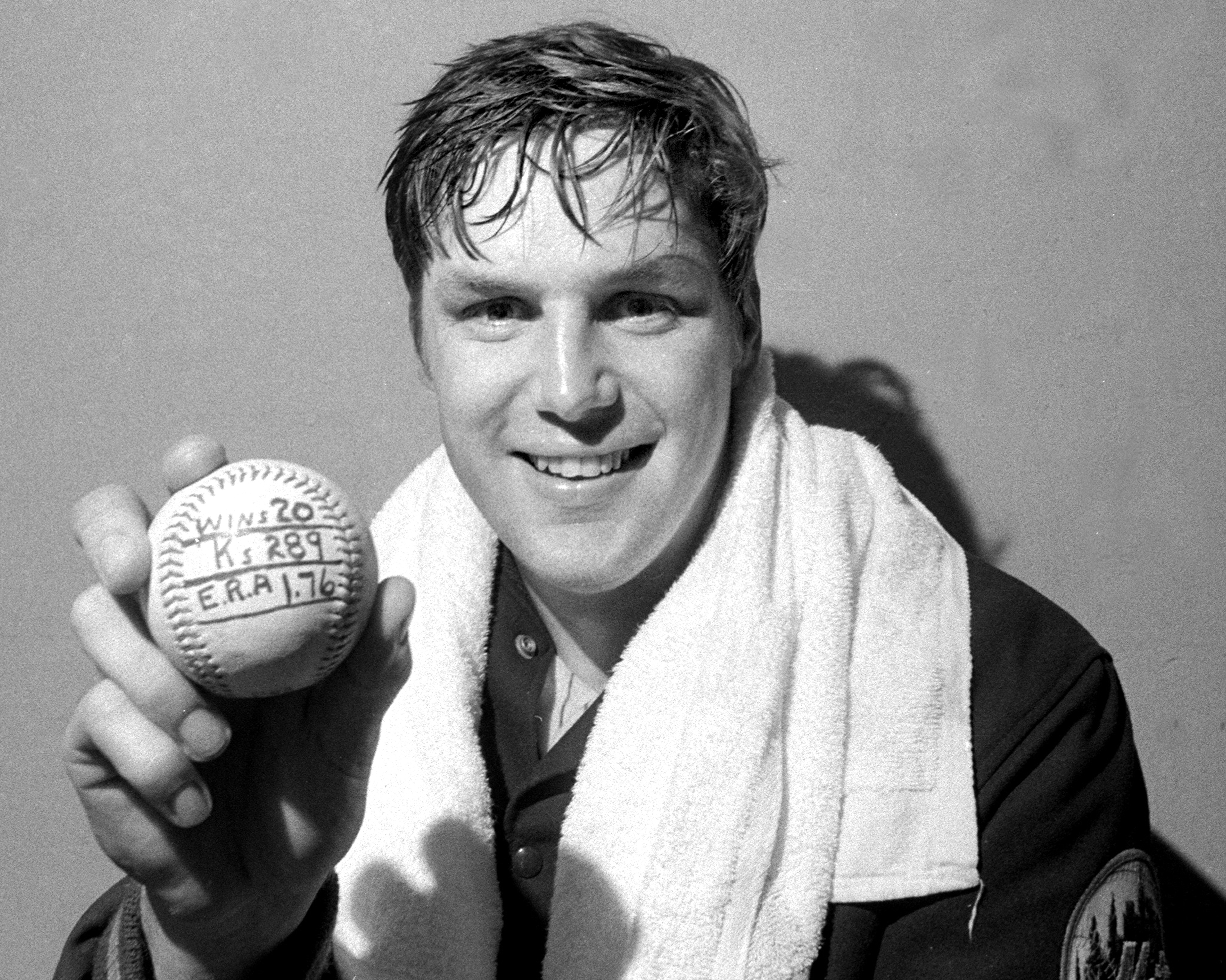 New York Mets' Tom Seaver has a ball noting his 20th win aft