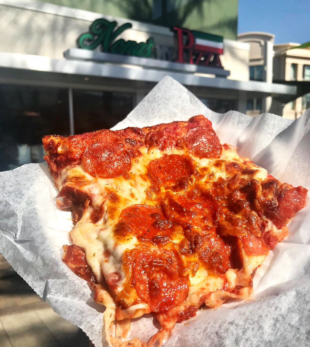 A New York-style slice, now available at Nona's Pizza at Town Square.