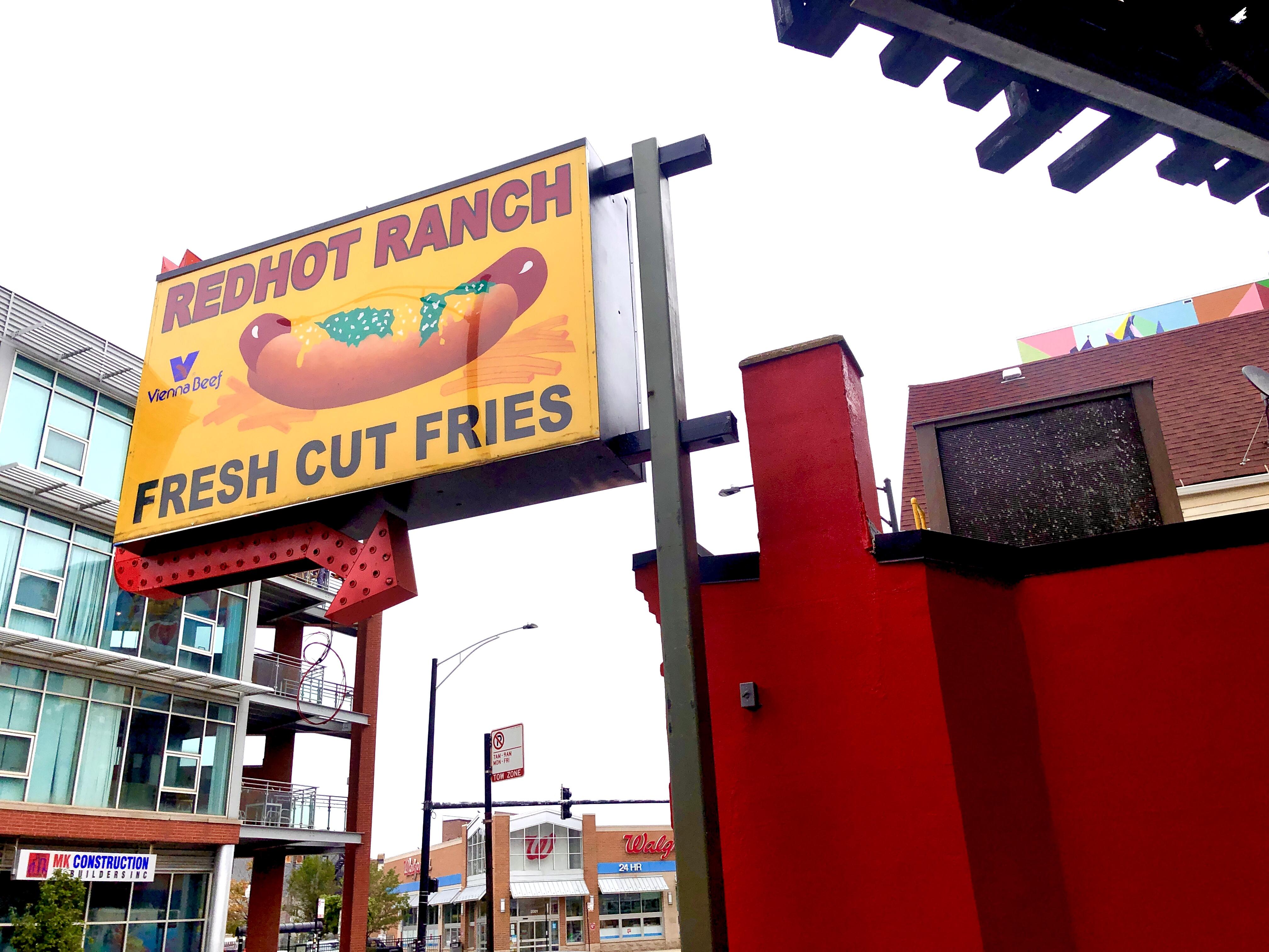 A sign depicting a hot dog.