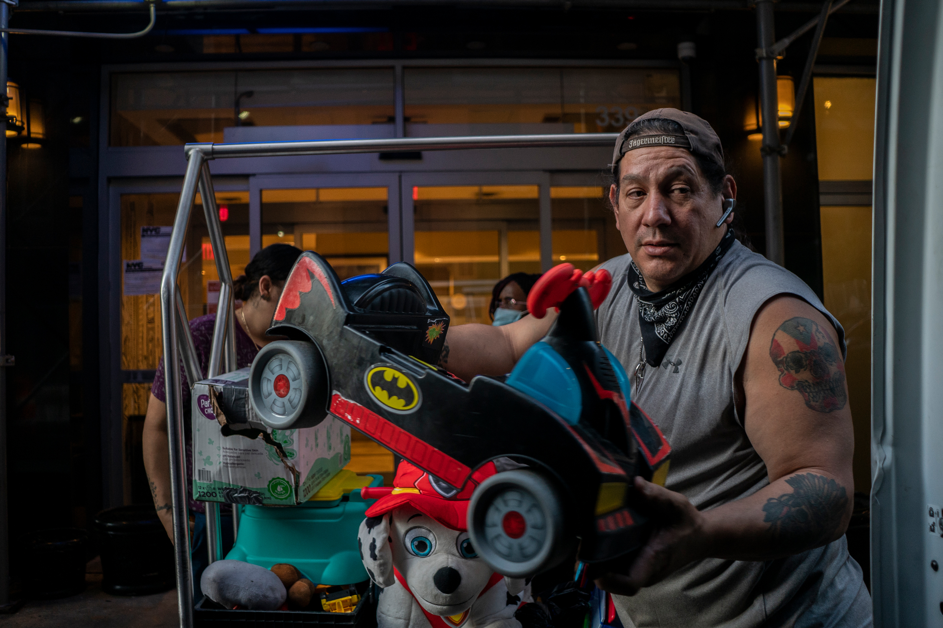 Michael Bonano helps Luz De Jesus load a moving van with her belongings from a Midtown shelter, Sept. 11, 2020.