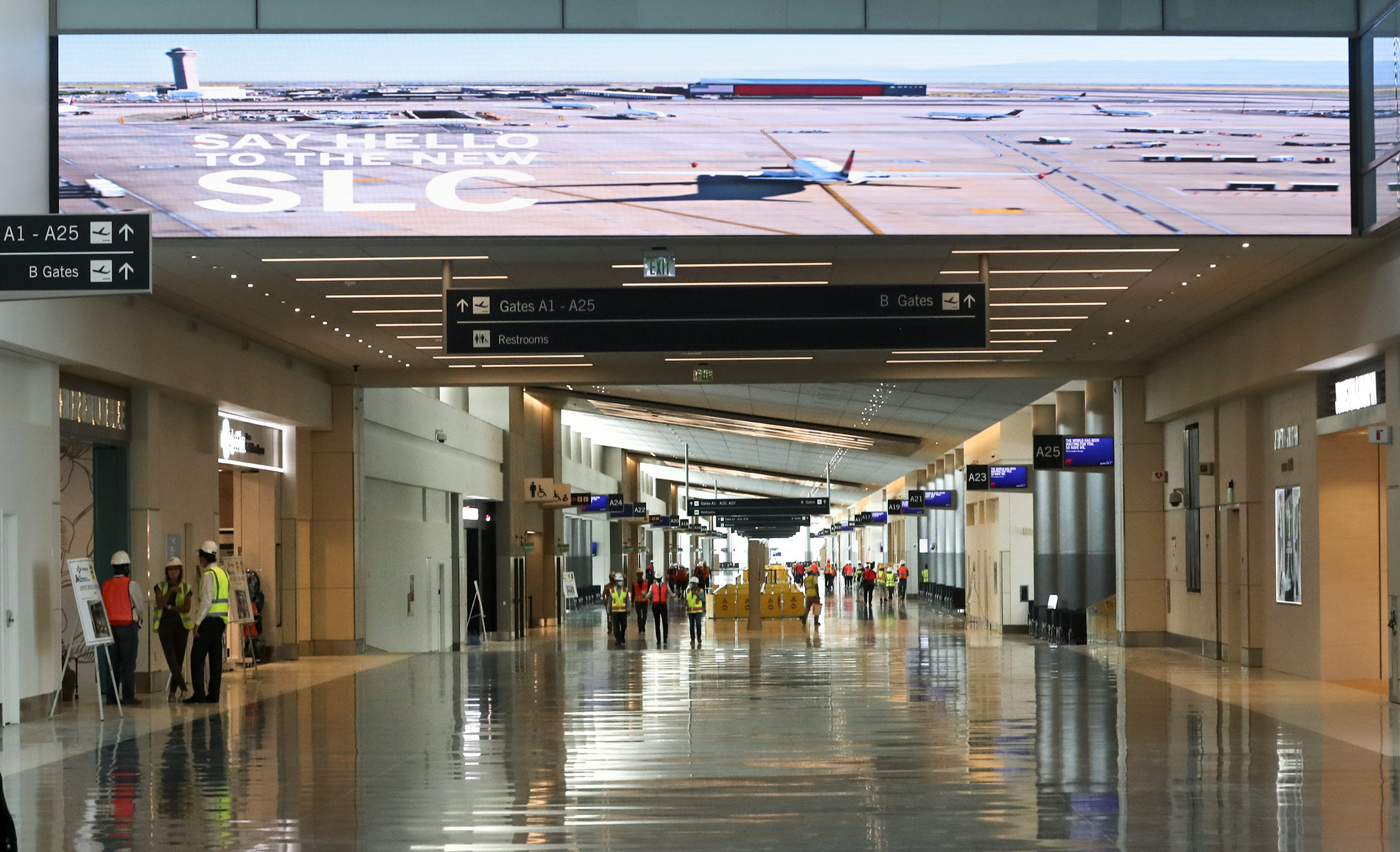 Members of the media and dignitaries tour the new Salt Lake City International Airport's main terminal in Salt Lake City on Thursday, Aug. 27, 2020.